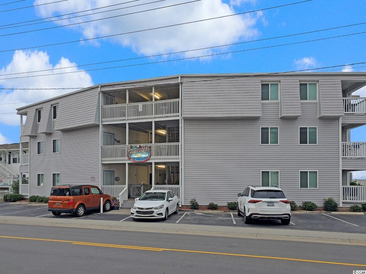 This rare and highly sought-after 'make it your own' condo is set within the Finestere development right in the heart of Cherry Grove. Whether you're on the hunt for an idyllic second home or a low-maintenance rental investment property to add to your portfolio, this is an impressive opportunity not to be missed. This condo is fully furnished with two bedrooms, two bathrooms and an open-concept living space. A peak of the ocean from your balcony provides the perfect backdrop to your new life of leisure with a host of contemporary comforts that will impress even the most astute house-hunter. You can head out and explore any one of the renowned local restaurants or stay in and cook up a storm in the kitchen.  The HVAC was replaced in 2021 plus there's an in-unit washer and dryer. All this is set on the first floor of the Finestere complex with residents also enjoying access to a selection of amenities. There's a community pool and an expansive ocean-front sun deck with picnic tables along with direct beach access and an outdoor shower area for rinsing off after a day on the sand.  The renowned Boulineau's Foods Plus grocery store is only a short drive away as are popular restaurants, live music venues, ice cream shops and the bustling main street. Shopping, golf courses, parks and pristine waterways are all at your fingertips and are just waiting to be explored.