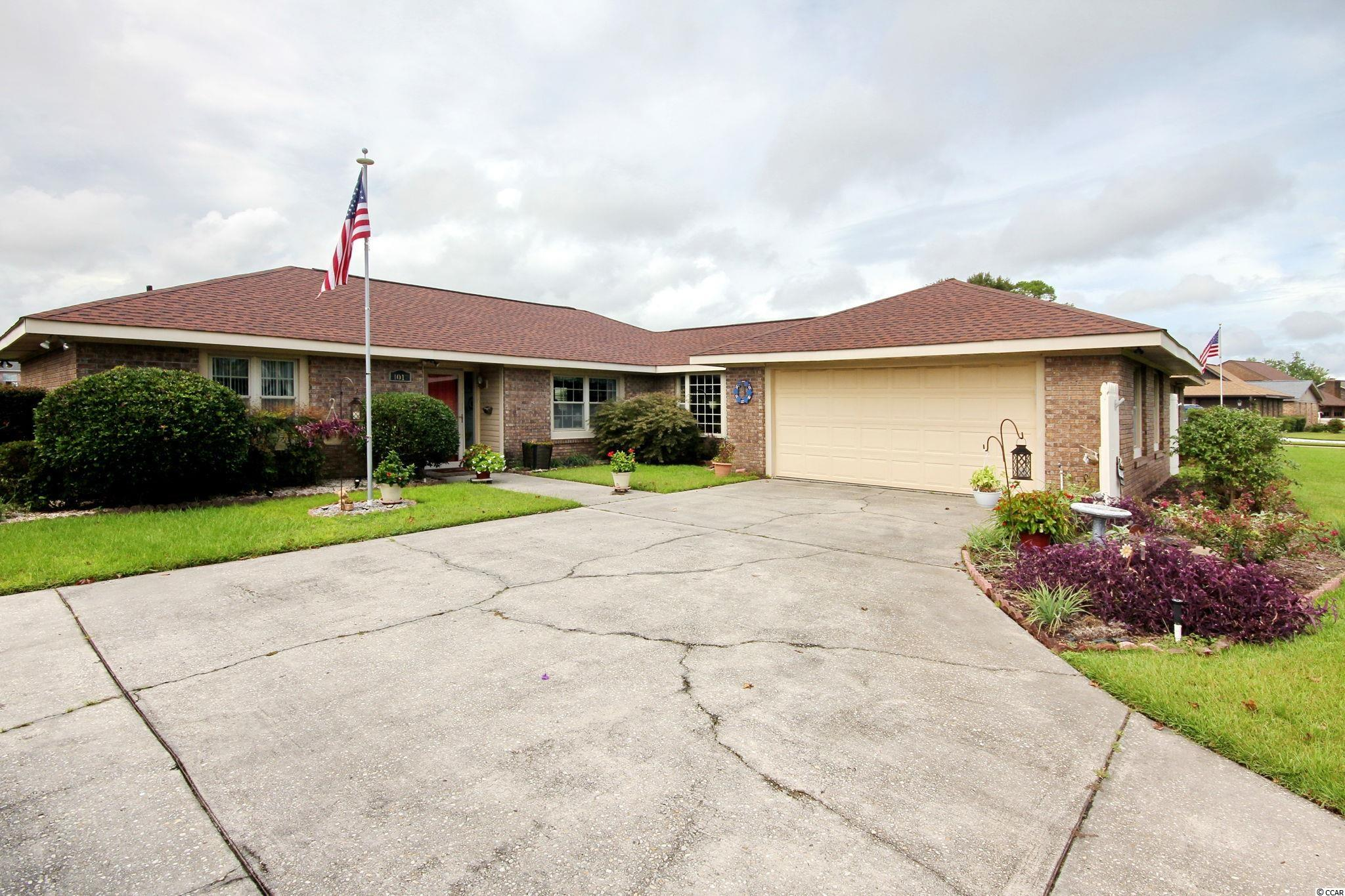 This Deerfield development is very sought after. Quiet neighborhood for convenience and privacy. It is located off business 17 and close to shopping, restaurants, and of course the beach. This nicely landscaped brick ranch style home boasts a wood burning fireplace, hurricane proof windows for loads of natural light, newer roof, HVAC unit, and hot water tank. This home features a bonus room just perfect for relaxing as you look out the many windows onto the back yard. The back patio is very nice for entertaining or enjoying the fresh air. You don't want to miss the opportunity to snap up this gem