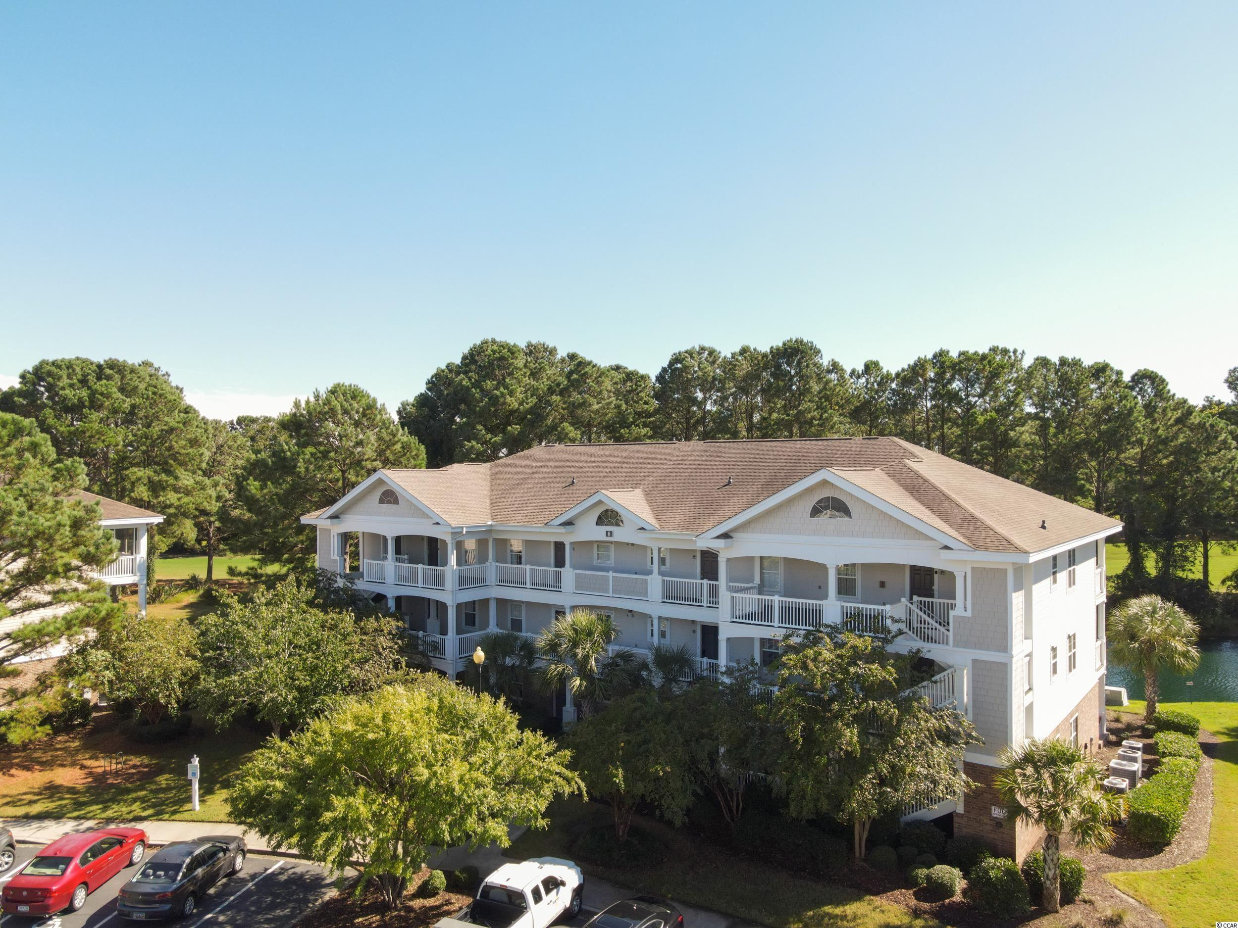 You won't want to miss seeing this beautiful Top Floor, 2BR/2BA condo located in the gated community of River Crossing - Barefoot Resort! This unit in building 8 has some of the BEST VIEWS in all of Barefoot and comes fully furnished! The balcony overlooks a beautiful pond with fountain as well as Hole #4 of the Greg Norman Course! The kitchen is updated with granite countertops, stainless steel kitchen appliances, and has a pantry. The great room offers vaulted ceilings, a spacious dining area, and open living room with lots of natural light. The master bedroom offers two closets including a walk in closet, en-suite bathroom, and 3 windows which overlook the pond and golf course! The guest bedroom offers privacy and is in close proximity with the second full bathroom. The condo unit offers a stackable washer and dryer, additional storage on the balcony, and a utility closet. River Crossing at Barefoot Resort offers lots of amenities including gated access, a community pool, access to a resort style pool on the waterway, access to the oceanfront cabana and parking, and a low HOA! Barefoot Resort is a premiere resort located just 2 miles to the ocean and close to many area attractions including Barefoot Landing, 4 professionally designed golf courses, and much more.