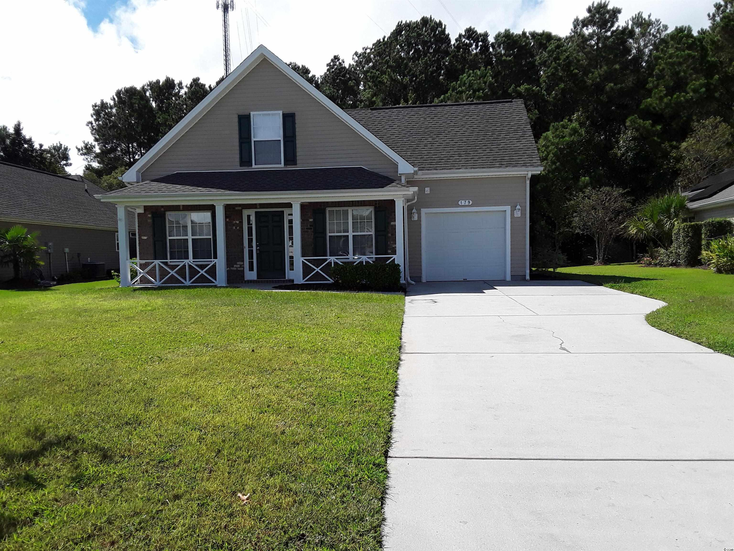 THIS IS A D.R.HORTON TRADITIONAL STYLE HOME WITH NEW APPLIANCES, FLOORING AND HVAC SYSTEM. Located in a golf course community at the challenging International Club in Murrells Inlet, this home offers many  amenities, including a community swimming pool, workout facilities and meeting rooms   The three bedroom, 2 and a half bath layout is perfect.  The home, built in 2007, including the entry level master bedroom/bath suite, is freshly and tastefully refurbished. And the home comes with great neighbors!