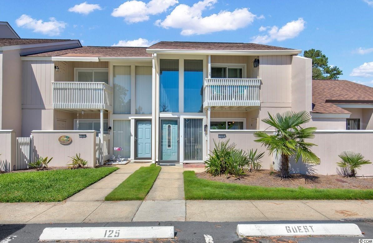 FANTASTIC LOCATION EAST OF HWY 17 IN N. MYRTLE BEACH.  EXCEPTIONAL 2 BR, 2 BA townhome style condo with lots of sunshine at The Pines off 11th Ave. N. just a short golf cart ride to the beach, new shopping center, restaurants, Surf Club, etc. Showing like a model, this stunning unit has been updated beautifully in the past several years and sells mostly furnished. Recent upgrades in the past several years include LVP style flooring throughout, interior painting, new HVAC in 2019, added mini-split upstairs in 2015, new ceiling fans, new light fixture in dining room, water heater and new toilets. Also new molding, rebuilt staircase and smooth ceilings are sure to please.  New vertical blinds recently installed in living room. The Pines community has updated the buildings, parking lot and pool within the last 5 to 6 yrs.  Exterior has been painted and roof shingles installed in 2015. Exterior covered patio offers privacy and is ideal for outdoor living. The well maintained, lovely community pool is closeby in a quiet setting.  Decks off both bedrooms provide a perfect spot to relax and enjoy the breeze.  Owners are allowed to have golf carts.  Short term rentals are not permitted.  HOA fee includes lawn maintenance, pool maintenance, exterior maintenance, and insurance (not including interior HO6 insurance).  As a permanent home or second home beach getaway, The Pines is located in a most desirable NMB location.  Don't miss out on this stunning opportunity!