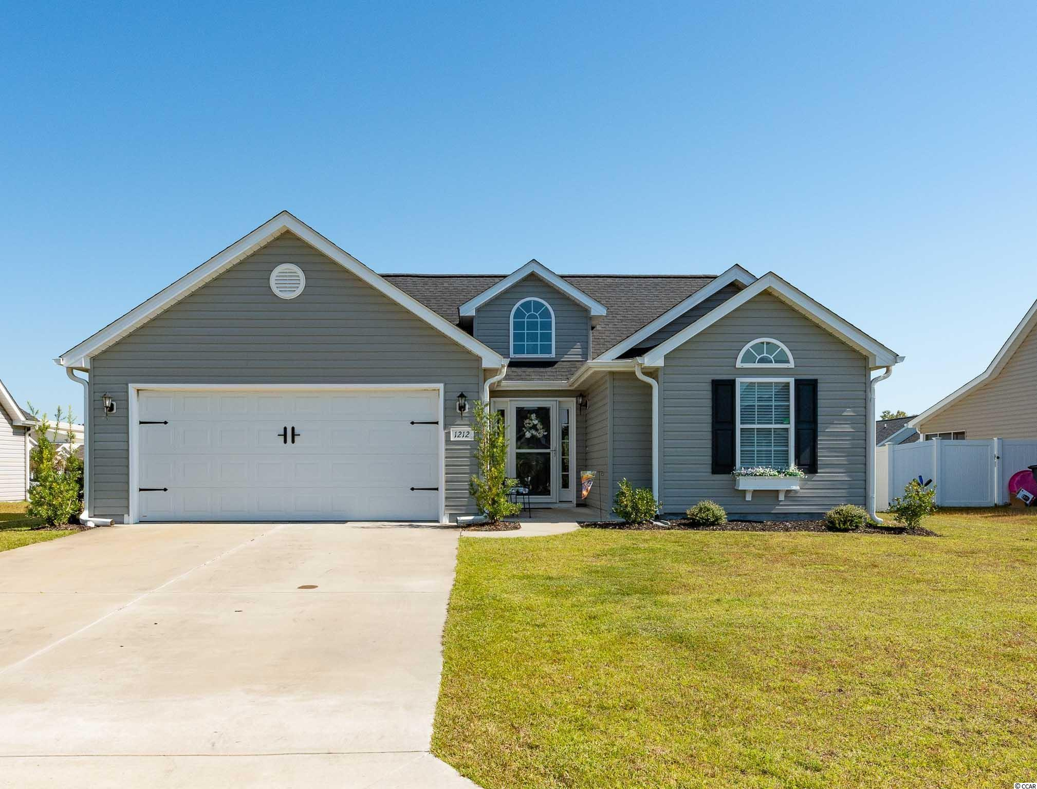 Welcome To Surfside Beach!  This Beautiful 3 Bedroom, 2 Bath Ranch Is LIKE NEW!  When You Enter You Will Find A Beautiful Entry with Vaulted Ceiling Opening To The Great Room, Kitchen and Dining Area.  Soaring Vaulted Ceilings & Tray Ceiling in Master Bedroom Make The Space Feel Open & Airy.  Split Bedroom Plan.  Vinyl Flooring Throughout, NO CARPET!  The Slider Door Leads to Back Patio With Gazebo, A Great Place To Sit & Enjoy The Coastal Carolina Weather.  Home Located On Cul-De-Sac. Mallard Landing Park is A Low HOA Community Within a Short Golf Cart Ride to the Beach and Close to Hwy. 17 Bypass & Business for Easy Access to Shops, Restaurants and the Airport. Measurements & Sq. Footage Approximate. and Not Guaranteed.