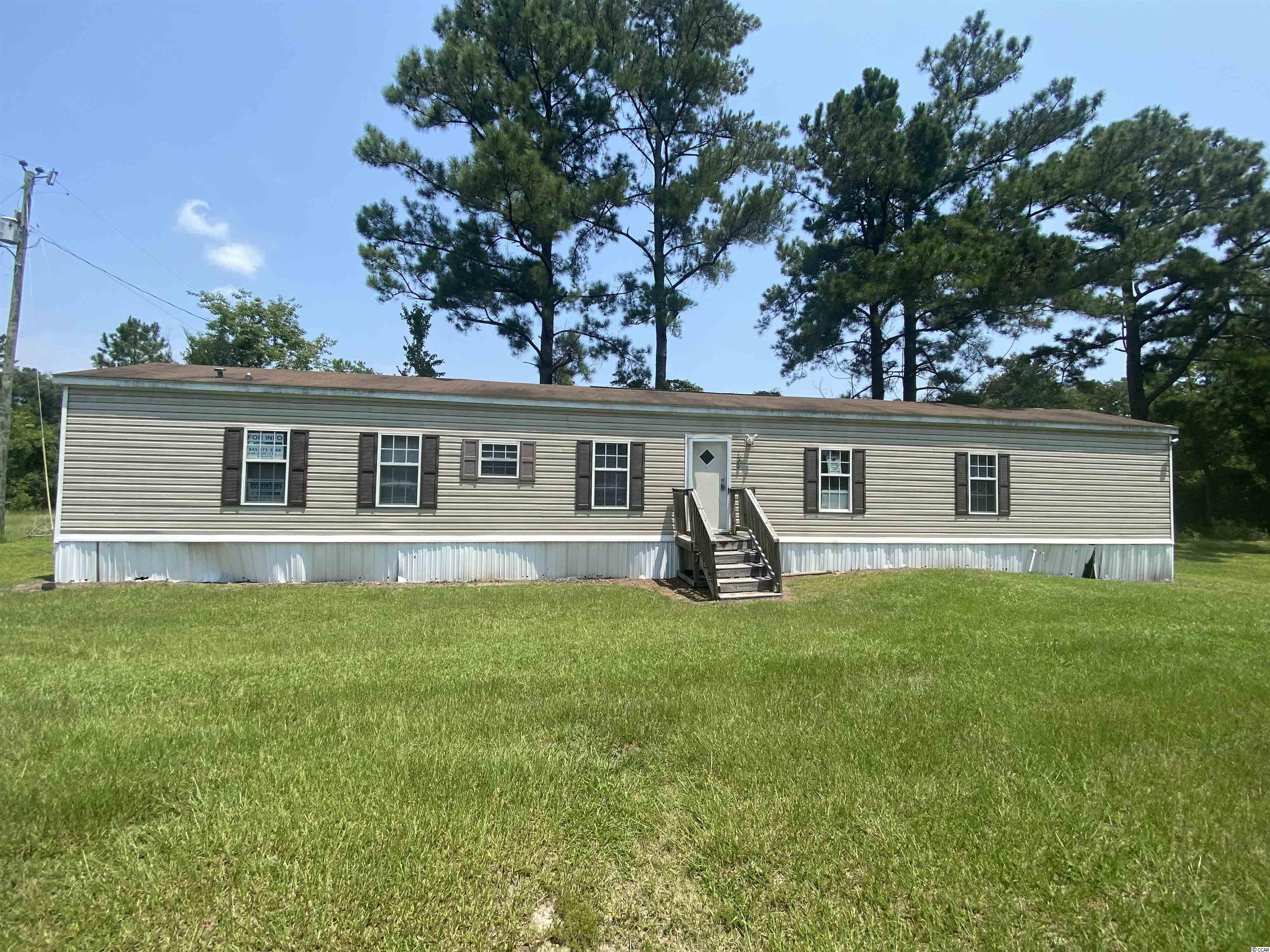 Single wide manufactured home on 2.4 acres. Well cared for three bedroom two bath home with new well and great rural home site.