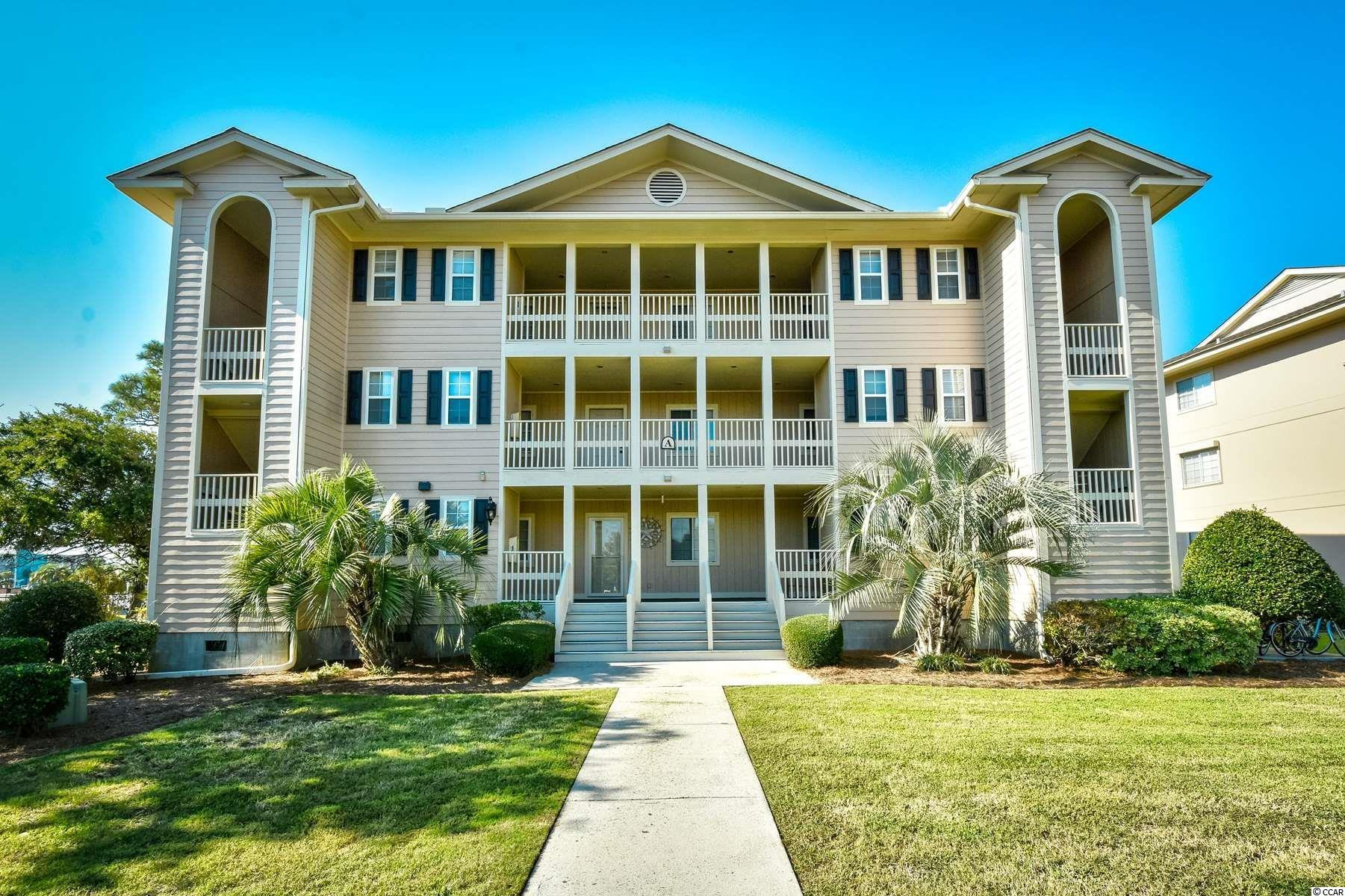 Don't miss this rare opportunity to own a 2 bedroom, 2 bath, FIRST FLOOR, end unit villa located in the desirable area of Cherry Grove, in the quiet community of Tilghman Shores.  Just a few blocks from the beach, this beautiful beachy furnished condo is perfect for full time living or a tranquil getaway.  Enjoy your morning coffee or afternoon cocktail on your screened in porch overlooking the pond.  The EZE Breeze windows on the porch will allow for extended use of this roomy living area.  There's an additional large storage closet  located right across from your front door that is available for beach chairs, etc. The community has a large pool, hot tub and grilling area which is located adjacent to the condo.  This prime location is within walking distance to a grocery store, restaurants, bars and of course, the beach.  Hurry, this move in ready beauty won't last.