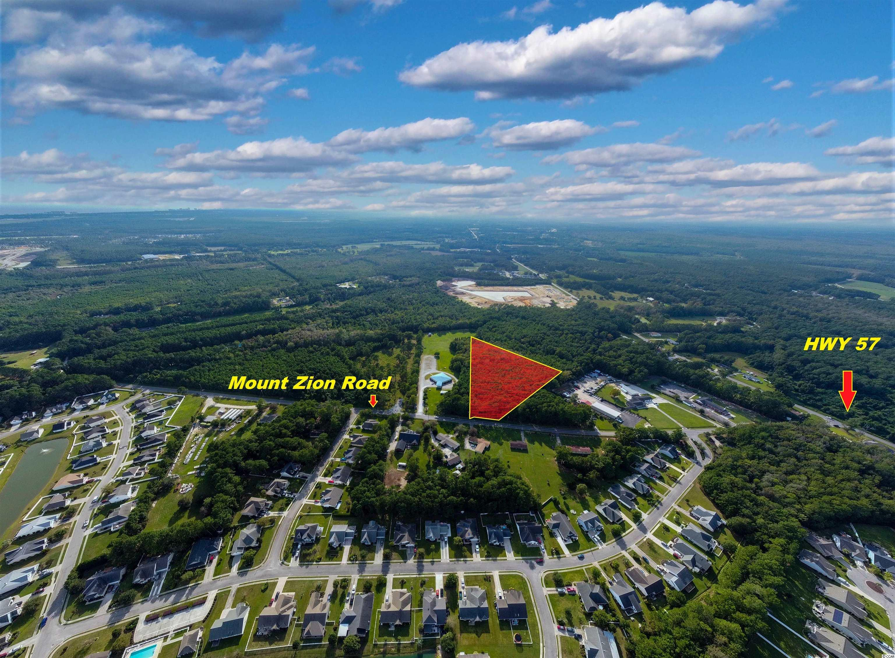THE PERFECT TRACT OF LAND FOR RESIDENTIAL DEVELOPMENT WITH APPROXIMATELY 200 FEET HIGHWAY FRONTAGE NEAR THE BEAUTIFUL WATERFALLS SUBDIVISION ON MT. ZION ROAD LITTLE RIVER. AND WITHIN 5 MILES FROM THE OCEAN AND THE BEAUTIFUL CITY OF NORTH MYRTLE. ENJOY THE CLOSE CONVENIENCE OF SHOPPING MALLS, RESTAURANTS, HUGE SPORTS, AND PARK CENTERS, LIVE OPEN-AIR VENUES, ENTERTAINMENT, AND ATTRACTIONS THAT WILL KEEP YOU EXPLORING  YOUR NEVER-ENDING WONDERFUL LIFE AT THE BEACH.