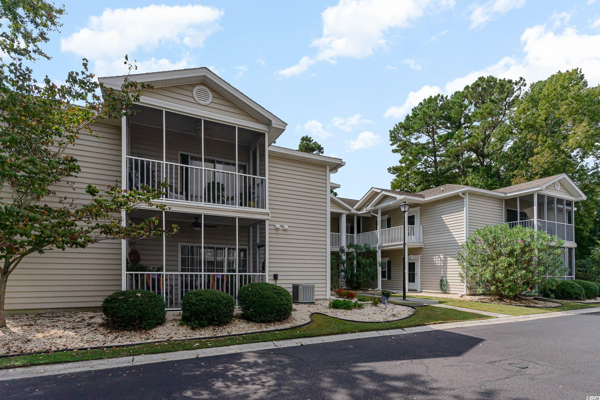 Terrific OPPORTUNITY to own the largest plan 3 bedroom , 2 bath , END UNIT, FIRST FLOOR condo is Sweetwater! This desirable unit features an open floor plan, hardwood floors in the kitchen, foyer and baths, laundry area with washer/dryer included, ceiling fans throughout, glassed-in screen porch, NEW HVAC 2019, and tons of storage. Sweetwater is a wonderful community offering owners SEVEN POOL options, tennis courts, temporary boat and RV parking, and beautiful courtyard gathering spaces. This home is just minutes from the famous Murrells Inlet Marshwalk, Brookgreen Gardens, great shopping, dining, multiple championship golf courses, all the essentials, and of course, THE BEACH! This would make a perfect primary residence, second home, or investment property. Don't delay!