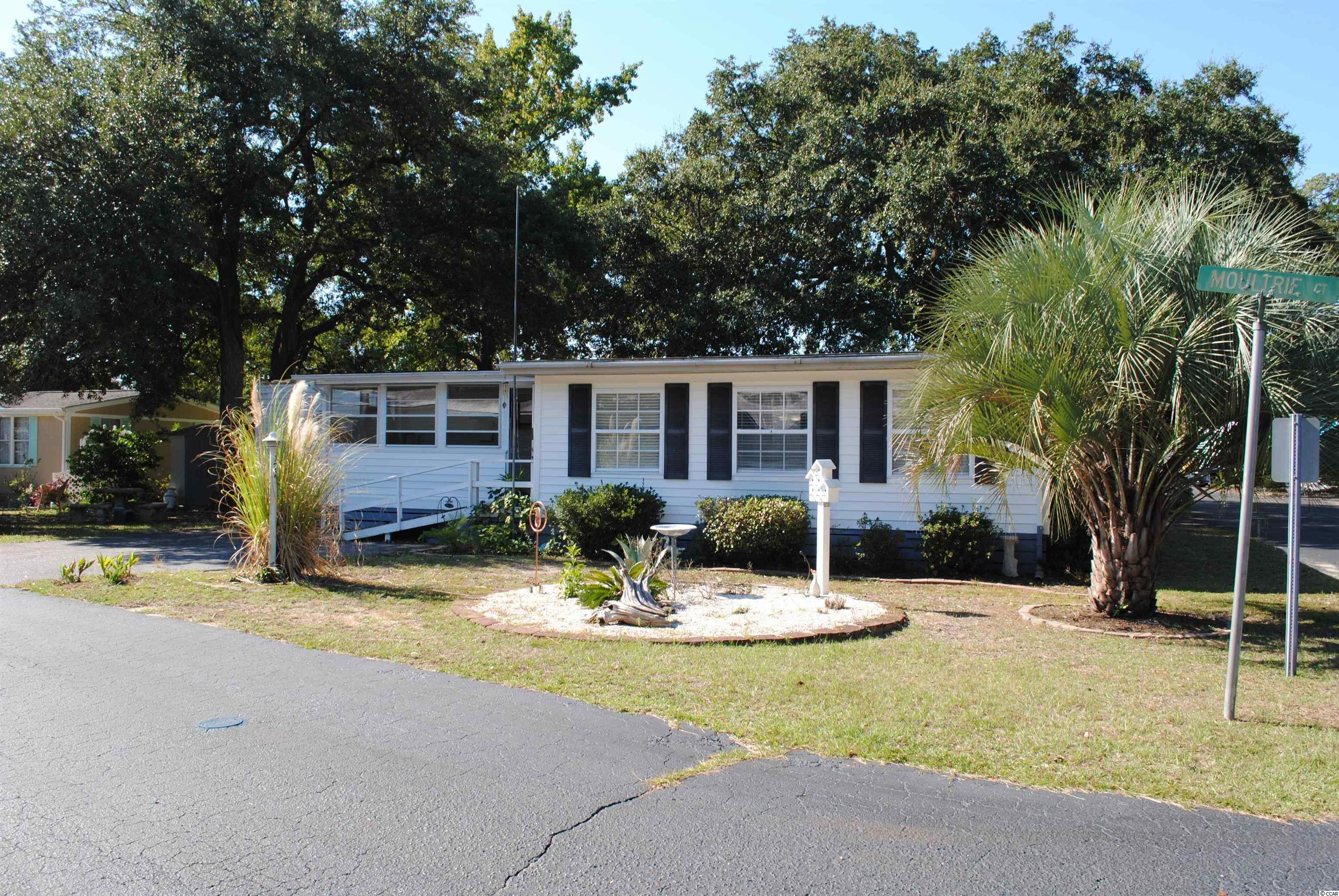 Come check out this home located in Inlet Oaks Village, one of the best kept secrets of Murrells Inlet.  This 55+ mobile home community is just a little over a mile from the ocean.  Inlet Oaks offers planned community activities by the Social Club, spacious clubhouse for cards, crafts, special events, library, free Wi-Fi, covered pavilion for picnics, games, billiards, horseshoe and cornhole pits, large outdoor swimming pool, and 3 ponds for fishing.  The community is also pet and golf cart friendly, restrictions apply.  Inlet Oaks is just a couple miles from the famous Brookgreen Gardens and Huntington Beach State Park.  Book your showing today to check out this  home and the peaceful community.