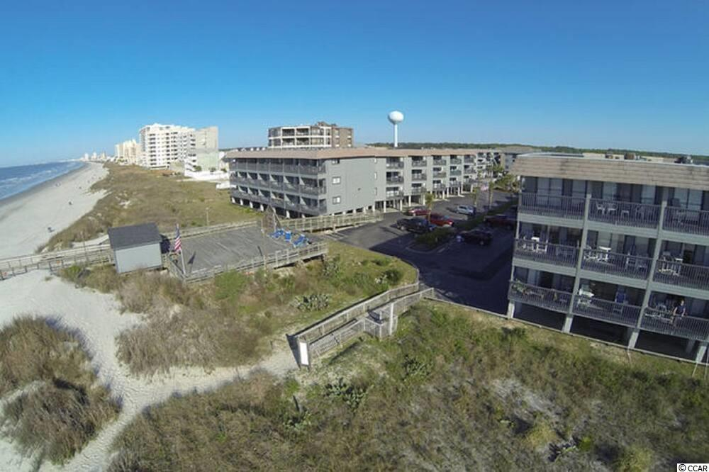 Don't miss this outstanding opportunity to enjoy your morning coffee on your private deck over looking the beach.  This unit is located in the first row of the Sea Cabin complex, so you are just yards away from the beach.  This units is extremely clean and features updated laminate flooring throughout.