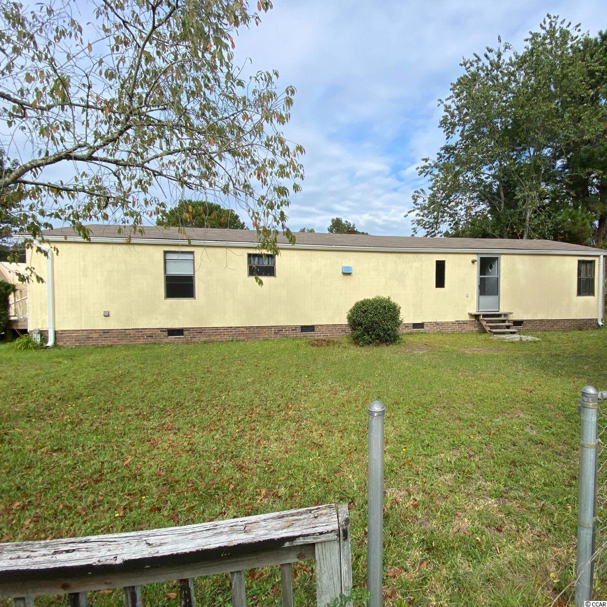 This is a great 3 bedroom, 2 bathroom manufactured home with land and no HOA! The home needs some minor repairs, flooring and paint. The washer and dryer and shed convey. This home is being sold 'AS IS'.