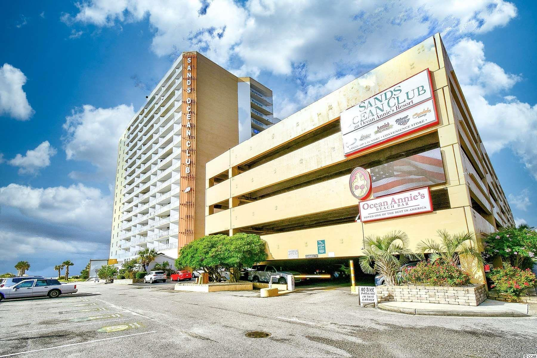 Don't miss your opportunity to own this completely upgraded 1 bedroom, 1 bathroom unit in the Sands Ocean Club.  This unit features LVP flooring throughout the entire unit with recessed lighting and an open floor plan of the main living areas. The kitchen is equipped with all stainless steel appliances, white granite countertops, updated grey cabinetry, and a breakfast bar leading into the living and dining areas. The bedroom also features access to your 2nd floor balcony, along with well coordinated furnishings and decor. Enjoy the beautiful ocean views from your 2nd floor balcony, and spend your afternoons at the many resort amenities. Sands Ocean Club offers indoor and outdoor pools, hot tubs, lazy river, onsite dining, laundry and exercise facilities, and more! Excellent rental potential and ready to move in or start renting. Whether you are looking for a second home on the beach or your next investment opportunity, you won't want to miss this. Schedule your showing today!