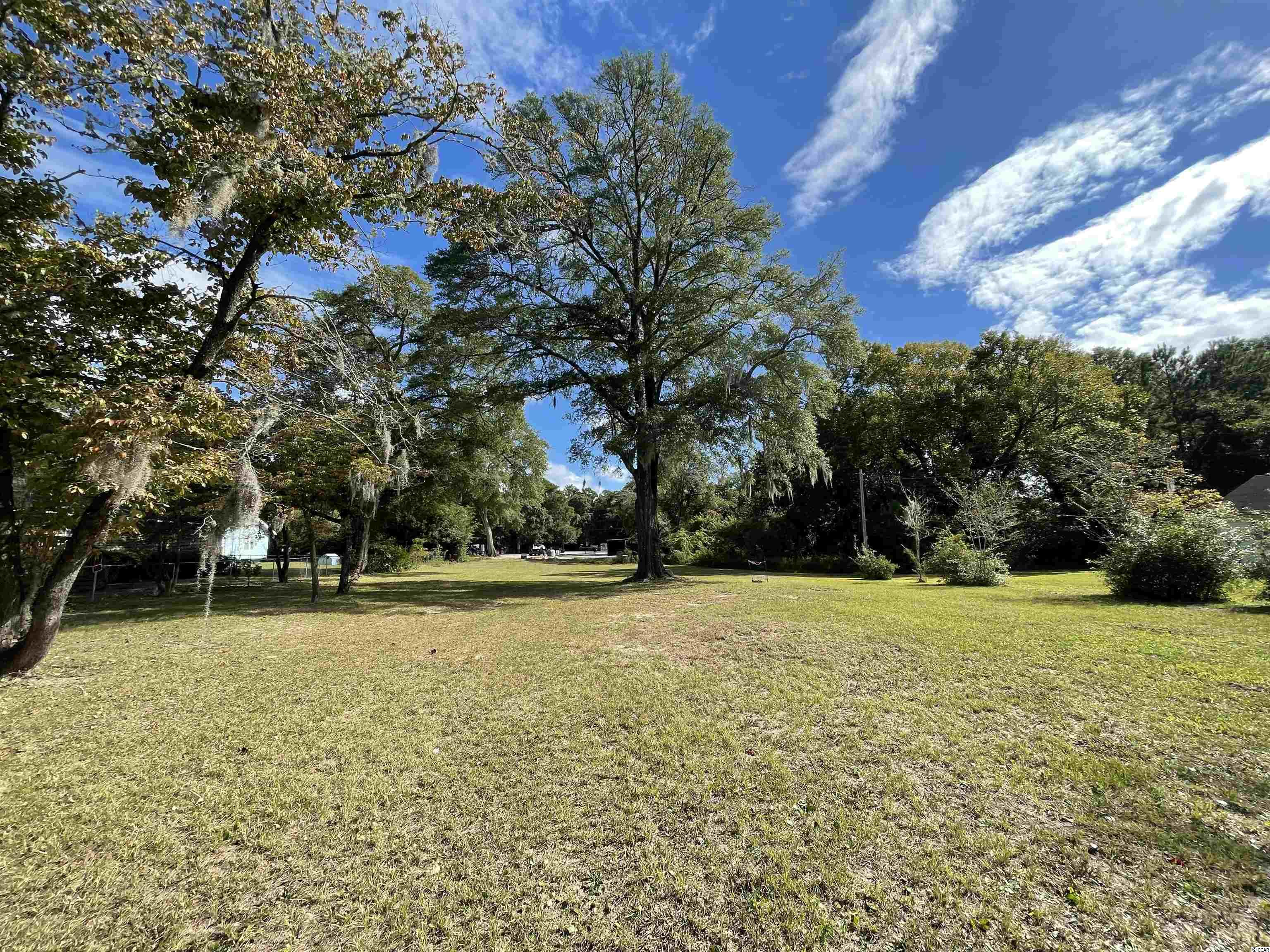 Drastically reduced price for not one but 2 cleared lots! This historic exceptional location sits on the horseshoe in Little River where the Casino Boat is located and the WORLDS famous Blue Crab Festival is held every year. This spacious lot offers so much adventure with Intracostal Waterway views, walking distance from local restaurants (with the best fresh seafood around), and a short boat ride from Bird Island. Live oaks on this just shy of a half acre will sure make a fantastic spot for your new home, investment...let your imagination run wild! Just minutes from the heart of Myrtle Beach, and a short distance from the North Carolina line lets you have the best of both worlds.