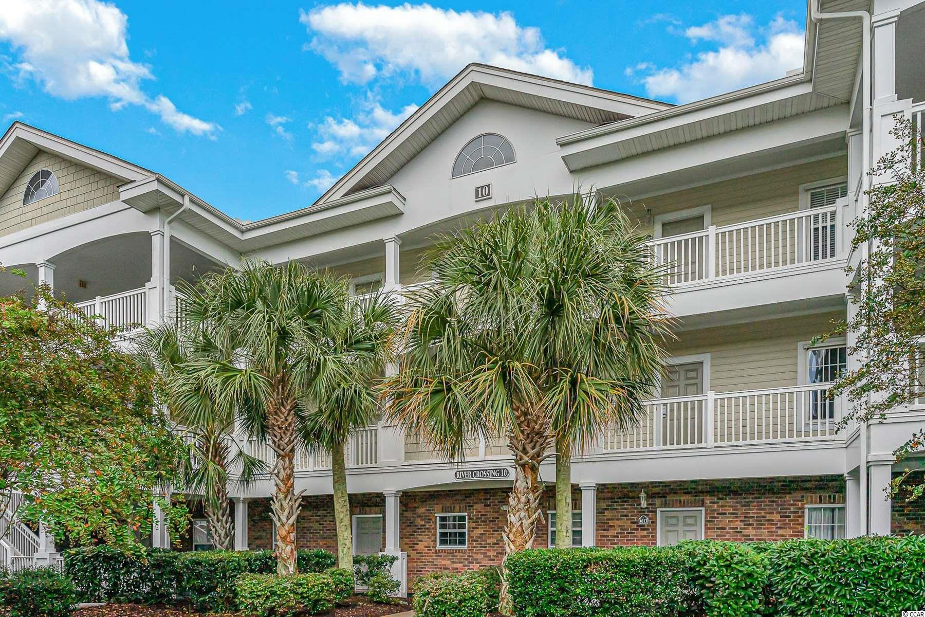 Welcome to this fully furnished, 2 bed, 2 bath unit in the highly sought after, River Crossing at Barefoot Resort. This unit features an open floor plan. The kitchen has an open window looking into the living & dining areas and plenty of cabinet and counter space. Each bedroom is spacious and offers ample closet space. Spend your afternoons relaxing on your balcony with. your favorite beverage.  River Crossing owners can enjoy access to all of the Barefoot amenities, including outdoor pools, clubhouse, tennis courts, oceanfront cabana, members club, and so much more! Hurry & schedule your showing today!
