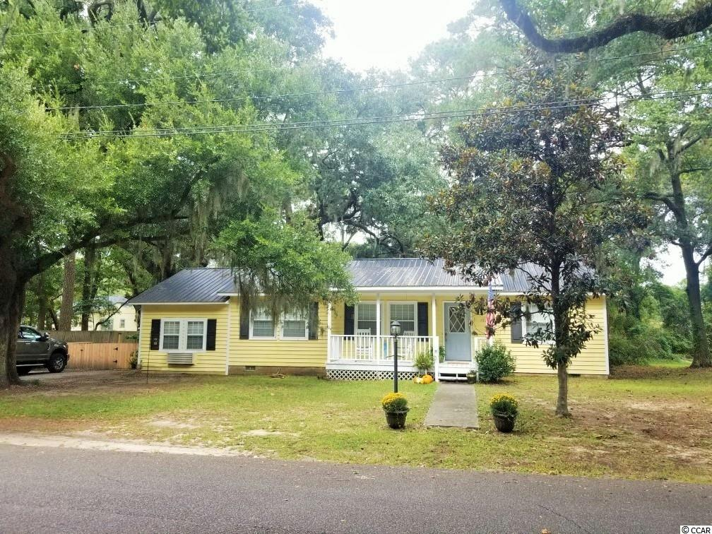 Cozy home in the Bayview area of Maryville and only minutes away from Historic Georgetown, SC and a very nice public boat ramp that gives access to countless waterways. Extra space created  by the converted garage which has it's own separate climate control. Split bedroom plan and spacious kitchen with dining area. The yard has beautiful oak trees, a large fenced in back yard and a workshop shed. Square footage is approximate and not guaranteed. Buyer is responsible for verification.