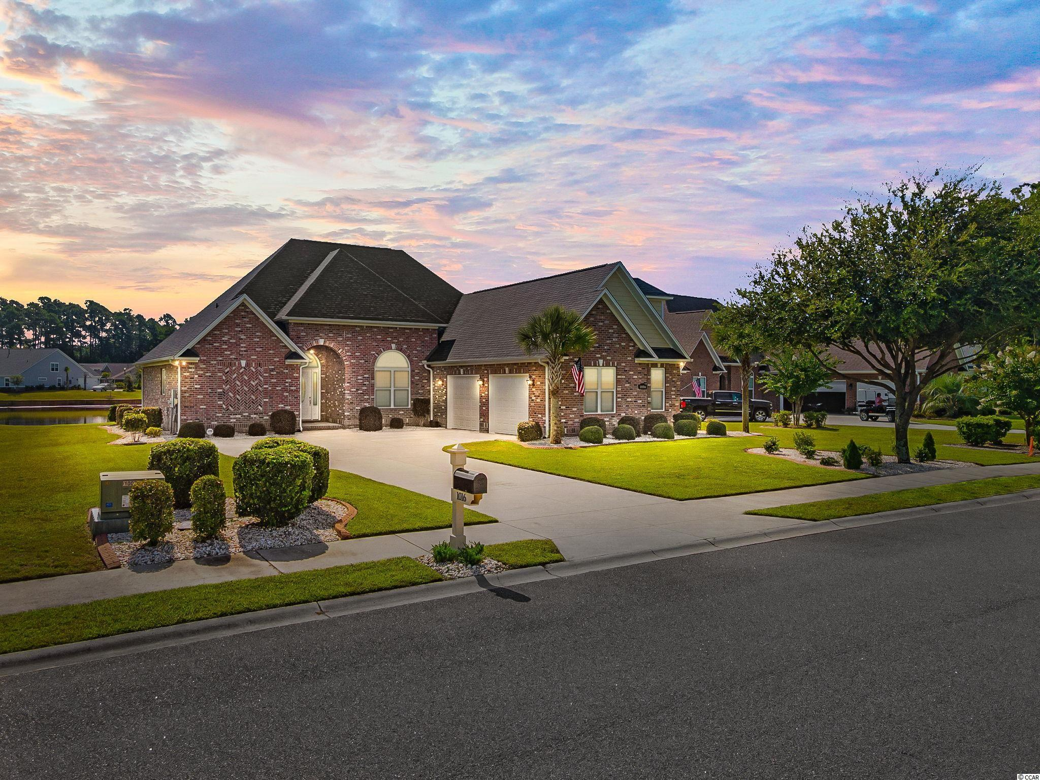 Don't miss this rare opportunity to own this better than new 4 bedroom, 3.5 bath home with an oversized 2 car garage on the large lake in the highly sought-after luxury lake front community of Wild Wing Plantation. This beautiful home is not your standard builder grade home, this is a custom-built home loaded with many extras and additional features. The stately front entrance and foyer welcomes you into this breathtaking home. The Great Room has stately 10' high ceilings, hardwood flooring, and gas fireplace. To the right is a formal dining room with 10 dramatic ceilings, wainscoting and large palladium window. The chef's kitchen features custom cabinets, luxury granite countertops, stainless steel appliances, tile backsplash, tile flooring, two pantries and even a breakfast area. Spectacular first floor master bedroom suite with views of the large lake, double tray ceiling, walk-in-closet, granite countertops, whirlpool tub, tile flooring, tile walk-in-shower, and his and her sinks. There are two additional bedrooms on the first floor. Upstairs there is a large den/game room area, additional bedroom, with full bath.   The rear of the home faces down the large lake, has a large screened in porch, paved patio area that offer unparalleled enjoyment of the many SC lake birds, including blue heron, egrets and even eagles. The exterior of the home features an impeccably manicured professionally landscaped backyard, with irrigation system and separate water meter.  Wild Wing Plantation has over 180 acres of lakes for you to explore and enjoy. You can even add your own private boat dock, use your boat to explore the lakes, fish and even take your boat to the clubhouse to also enjoy the many amenities there. The community features custom built brick and stucco style luxury homes. Association amenities included large clubhouse, multiple outdoor pools, hot tub, 80' waterslide, tennis/pickle ball courts, basketball court, new fenced in playground area, huge day dock, private 