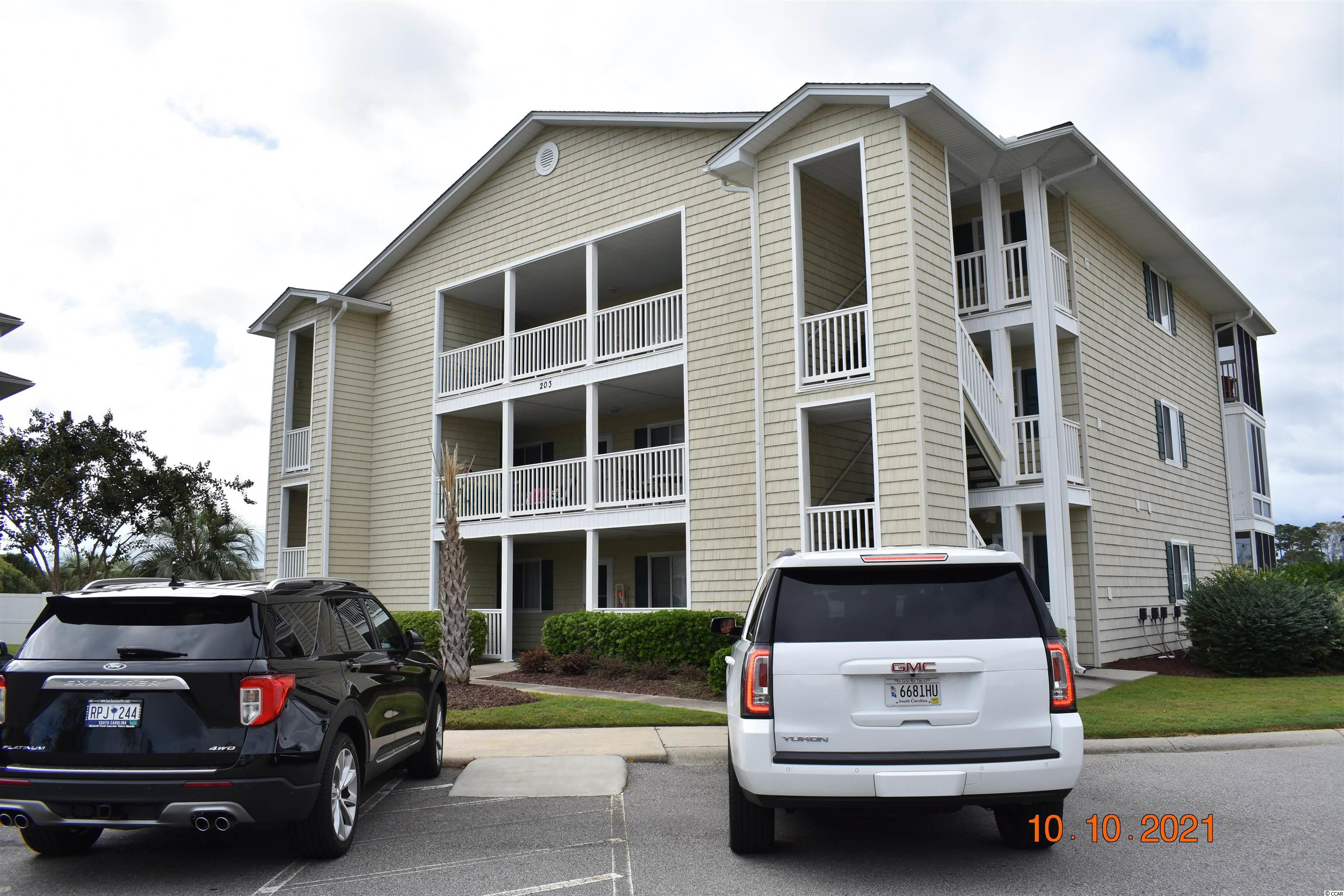 First floor end unit in established gated-community.  Lots of natural light, privacy, and peaceful views.  This two bedroom, two bathroom condo has never been rented.  Beautiful screened in porch.  Includes owners closet and access to docks on the waterway for fishing or relaxing.  Golf carts are not allowed. Beautiful complex with a large community pool.