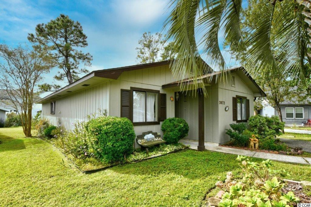 2072 Lake View Circle is in a secluded area of Deerfield Plantation called Village on the Green. Situated on a quiet cul-de-sac the home is ideal to escape the hustle and bustle of the beach. There are 3 generous bedrooms and two baths a large 500  sq ft open concept living area with ceiling fan built ins and parquet flooring and new roof. Adjacent to the living area is a large dining space that leads to the remodeled galley style kitchen and laundry room. The master suite is equipped with a ceiling fan, sitting area and wood flooring. The large back patio with sunshades and ceiling fan is a gardener's dream, overlooking the beautiful backyard sanctuary of  sitting areas, raised gardens, boarder gardens and a storage shed. This home has  so much character and personality just waiting for you to make your own! Close to everything that the Grand Strand has to offer. The beach, shopping, dining, entertainment, shows, golf, airport, The Market Common, the pier, and of course the beach!!
