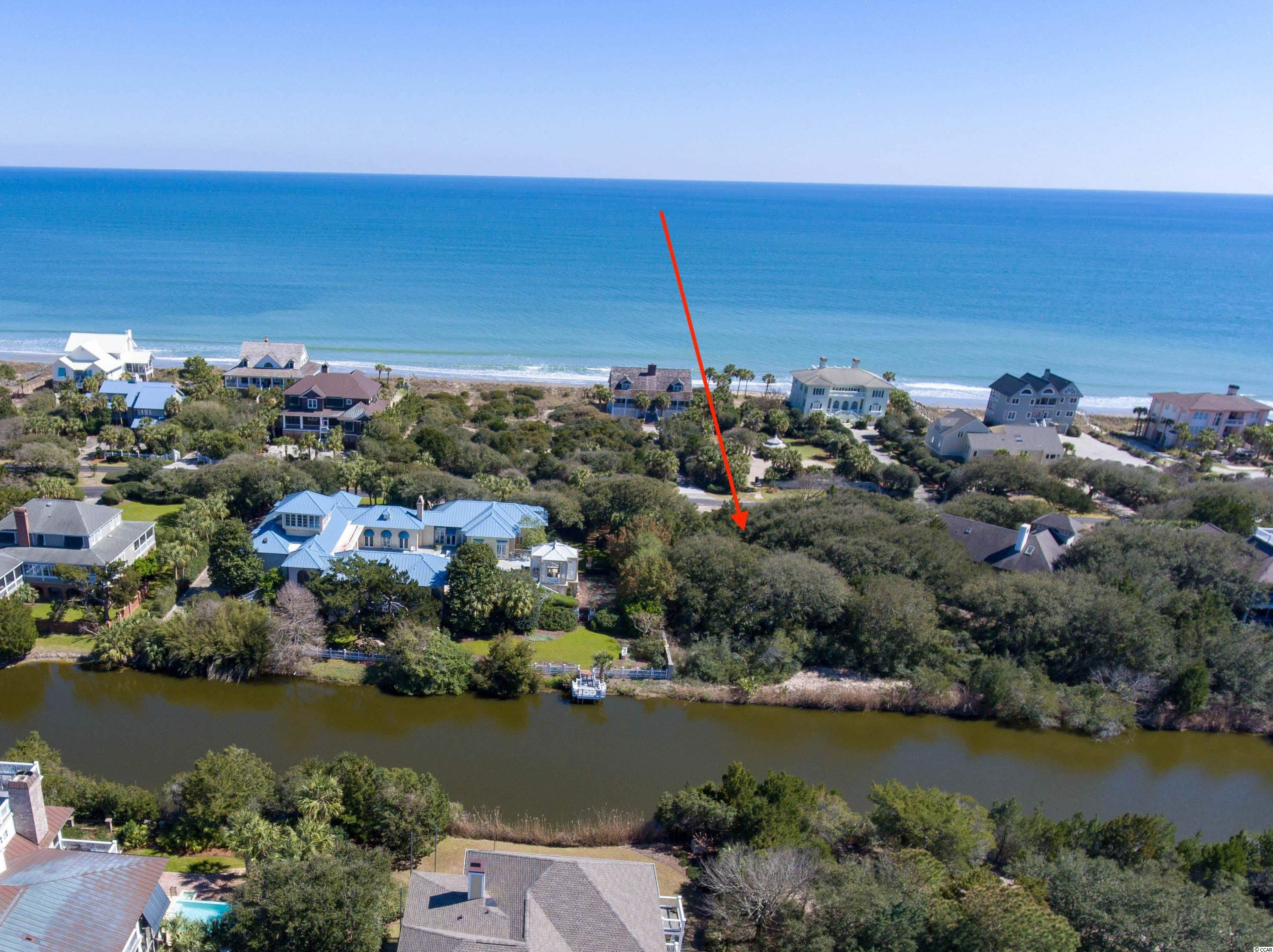 Lot 5 DeBordieu Blvd. is a beautiful 2nd row property with direct access to the beach close by. The lot is heavily wooded with several Live Oaks and the back of the property overlooks Yahanney lake. This is a great opportunity to be in close proximity to the oceanfront for any beach lover.
