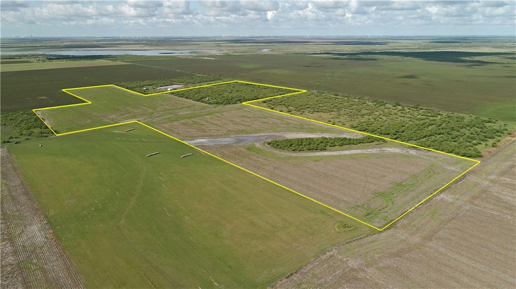This 50 +/- acre farm is located just west of Bayside at the end of Vega Rd. It has electricity and a deep water well water. The land consists of approximately 10 +/- acres of native pasture, with thick mesquites and native grasses, and 40 +/- of crop cultivation. The pasture is partially fenced, if you wanted to run some cattle or horses. This tract of land will have whitetail deer, feral hog, dove, and some quail going through it. There is a pad where a barn stood that no longer exists due to Hurricane Harvey. Tractor and cutter convey with the property. This is a beautiful piece of land to with space build a homesite or continue to cultivate and visit on the weekends for some great dove hunting opportunities!  Legal Description: F/TS 273-274-275-276 277-327-328-333-334 J DE LEON AB-43 F/TS 273-274-275-276 277-327-328-333-334 J DE LEON AB-43