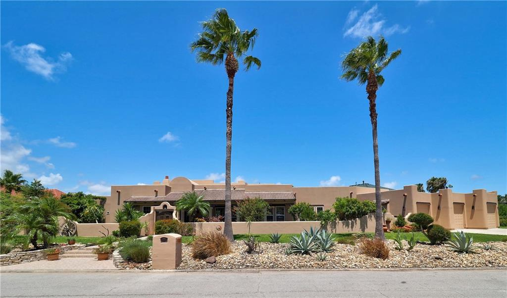 Welcome to Santa Fe by The Bay! This absolutely gorgeous 4 bedrm/3.5 bathrm, 5598 sq ft Santa Fe Home sitting on a little over 1/2 an acre is located in the prestigious sea-gated community of Pelican Cove! This home is designed for entertaining! Walk in to a stunning view of the pool and canal...there is Latilla wood on the ceilings in the entryway and Primary bedroom that is just beautiful. Cantera Stone Pillars are throughout the living area. Each bedroom has its own private patio entrance. The kitchen is a chefs delight with a Thermador Professional Stove with 6 burners and a griddle and 2 warming drawers. 2 built in ovens and much more! The kitchen cabinets are built with Alder wood that you can also find throughout the house. Beautiful Plantation shutters cover the windows and doors leading out to the back patio. There is an air conditioned Cabana with an outdoor kitchen and full bathroom. An amazing 20X40 ft pool and a 100 feet of water frontage for all your water toys!