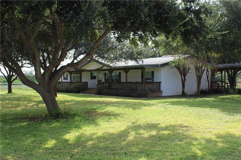 Own a ranch, use it, graze it, hunt it, live on it, and make an investment all at the same time. You can't hunt deer off your back porch on your 401K, but you can here. Perfect size and and convenient location. Fantastic south Texas brush and big bull mesquites. Plentiful wildlife. Superb metal building(40 x 50) that offers equipment storage and and working shop space. Metal pipe pens. The center piece is a ranch home in very good, move in ready condition. Ideal location overlooking a tank, complete with mature live oak tree shaded yard. 3 car garage, sprinkler system, and more.  This place has it all!