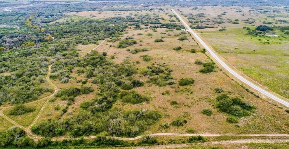 Lagarto Creek Ranch, 105 acre ranch for sale in Live Oak County. Where S TX meets the Gulf Coast, a wonderful retreat close to Lake Corpus Christi, convenient to Corpus Christi and San Antonio. A fantastic getaway for recreation and relaxation, as well as hunting, fishing, along with all the other lake and coastal activities you can imagine. Just a mile west of Lake Corpus Christi and accessed from paved FM 534 giving frontage of over 7,000 feet. It is under 15 minutes from I-37, 1 hour from Corpus Christi and an 1.5 hours to San Antonio. The land has an uncharacteristic land rise for the region. The ranch is low fenced and dotted with hardwood trees across grassy pastures, with a larger wooded area on the northern portion of the property. The soil on the ranch is a deep, fine sandy loam that supports diverse brush and native grasses perfect for grazing livestock and roaming wildlife. Wildlife is plentiful as a result of the creek and large neighboring tracts.