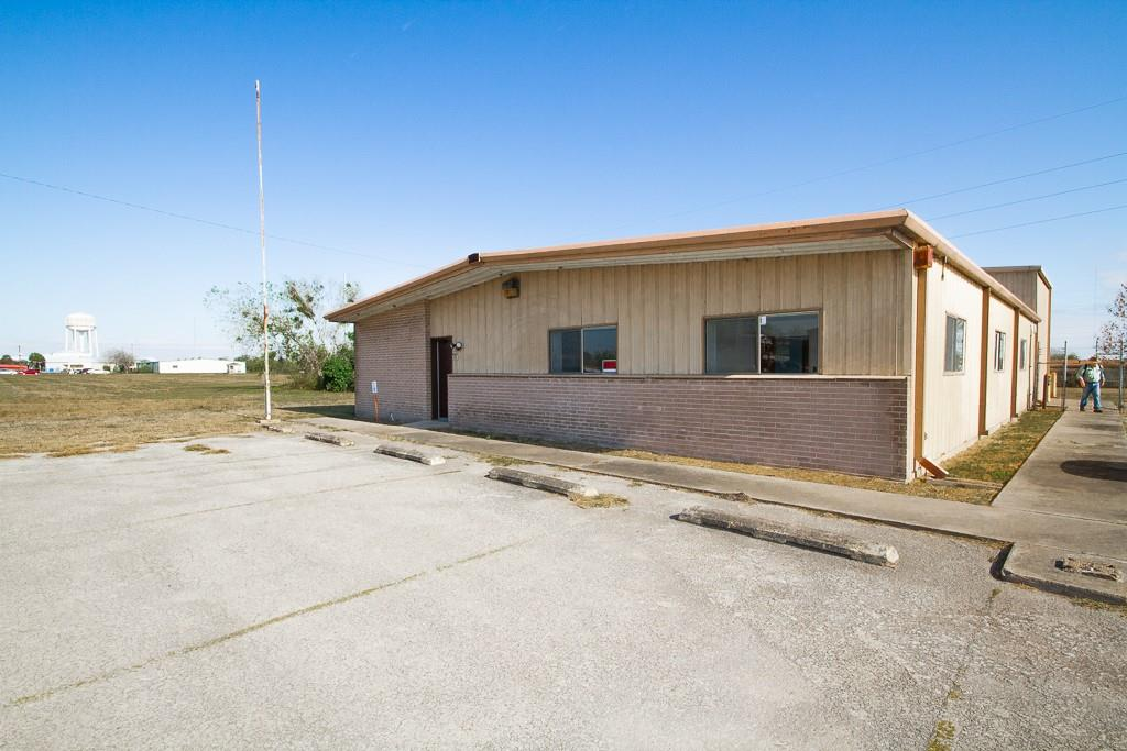 This large, move-in ready office building is situated on 1.49 acres conveniently located off the US Hwy 59 truck route (FM 351) around Beeville. Building is 50' x 80' & features a total of 5000 sf, with 4000 sf on the main floor and 1000 sf of storage upstairs.  Includes 10 spacious offices, reception area, a large conference room, 2 complete restrooms with showers, a mechanical room, and a huge storage room upstairs with very ample shelving.  There are 21 parking spaces in front, a chain-link fenced back yard and over 20,000 sf of asphalt pavement. Plenty of room for expansion! Other amenities include (2) 20' x 40' metal buildings, each a with 9' W x 10' H rollup door, which can be used for storage or as work area. This property is for sale or lease.  Call MGM Real Estate for lease details at 361-358-2010.
