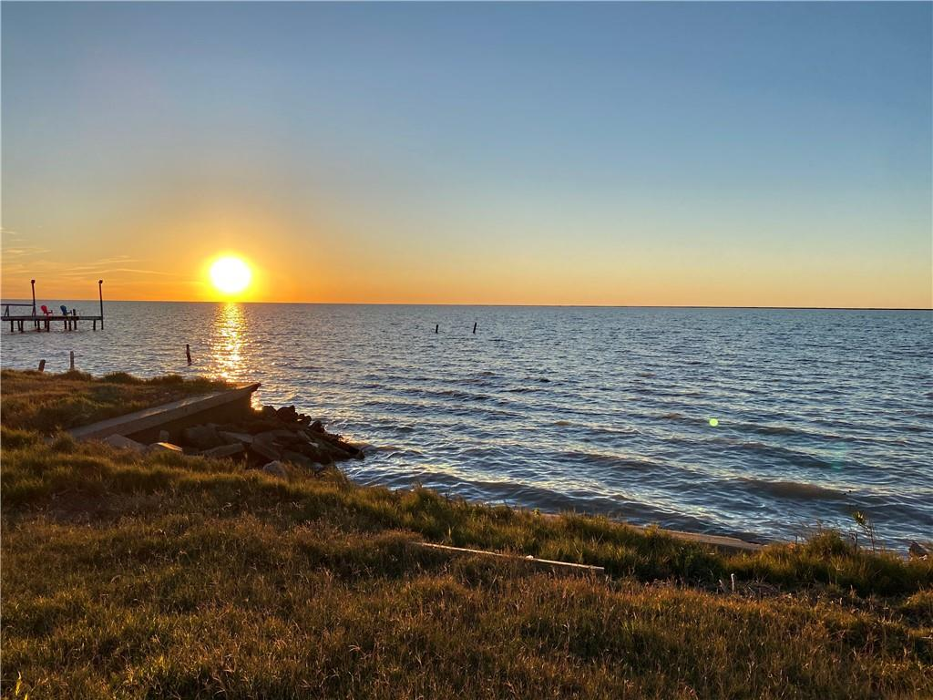 Call your builder! Don't miss out on this waterfront lot on beautiful Copano Bay. This large, cleared lot is ready for your dream home or beach getaway. Enjoy fishing, wildlife, and breathtaking sunsets in your own backyard. Holiday Beach HOA provides access to two boat ramps, a clubhouse, a private pier, and swimming pool for a small annual fee. For more information about this neighborhood, visit https://holidaybeachtx.org/. Adjacent lots are also available. Lot 11, MLS#376706 Lot 12, MLS# 376708