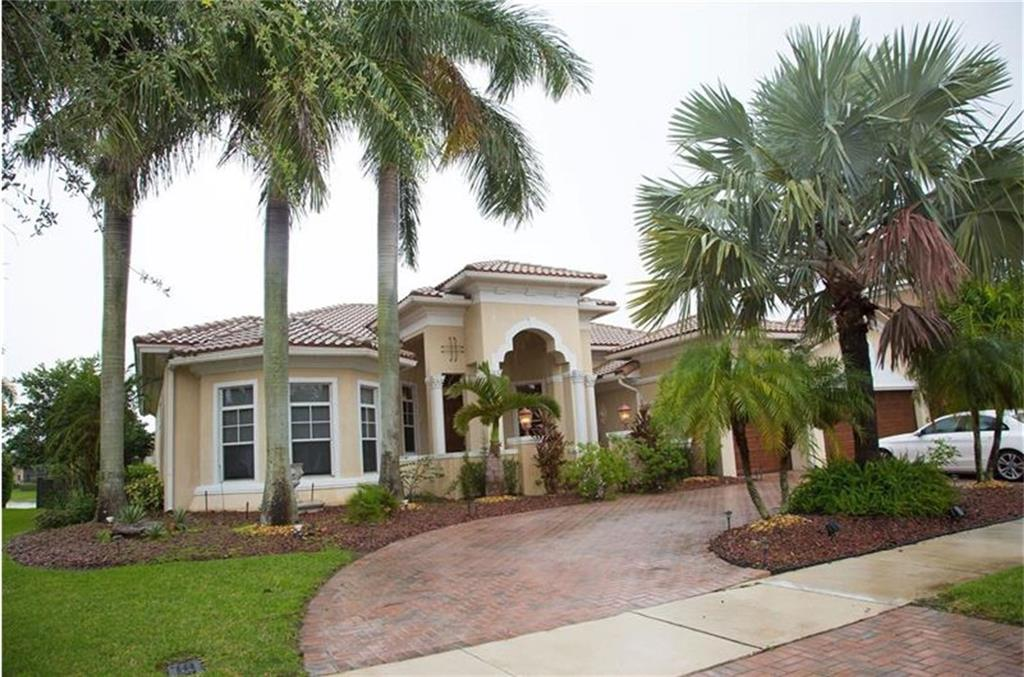WOW!! FABULOUS HERON BAY ONE STORY MODEL - BEAUTIFULLY UPGRADED!!! Marble floors and gorgeous marble bar with an incredible fireplace in living room. Kitchen has upgraded countertops and new sink. The family room has huge windows that look out to a fantastic pool area and lake view. Outside fire pit built-in for entertainment! So many upgrades to see!