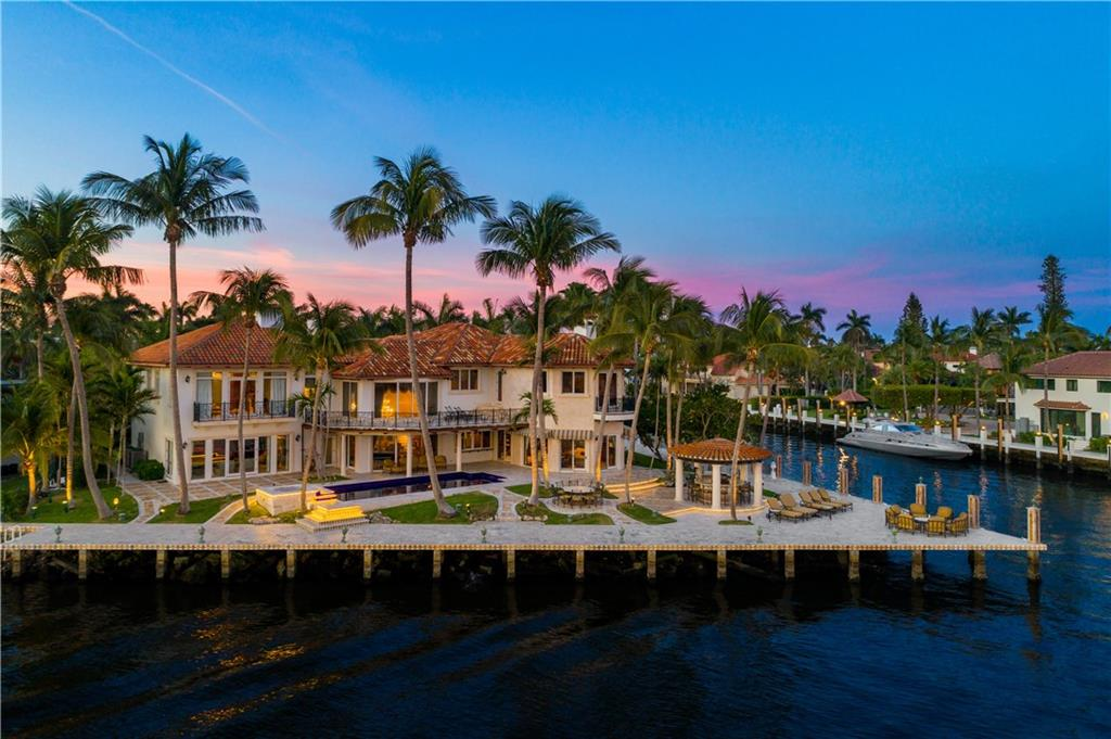 435 ft of deep water dockage. Secluded in a park-like environment within Las Olas Isles, patrolled by private security, surrounded by water on three sides. Isle of Capri Peninsula estate offers its new owners limitless views of the New River and the Intracoastal waterway from every room. Within few minutes of the Atlantic Ocean. Features an enormous master bedroom with his and hers walk-in closets, and with spa-like bathrooms, morning bar, a huge terrace, dining and magnificent views. Includes a separate 2780 square feet guest house with two car garage. Property includes both 518 & 524 Isle of Capri