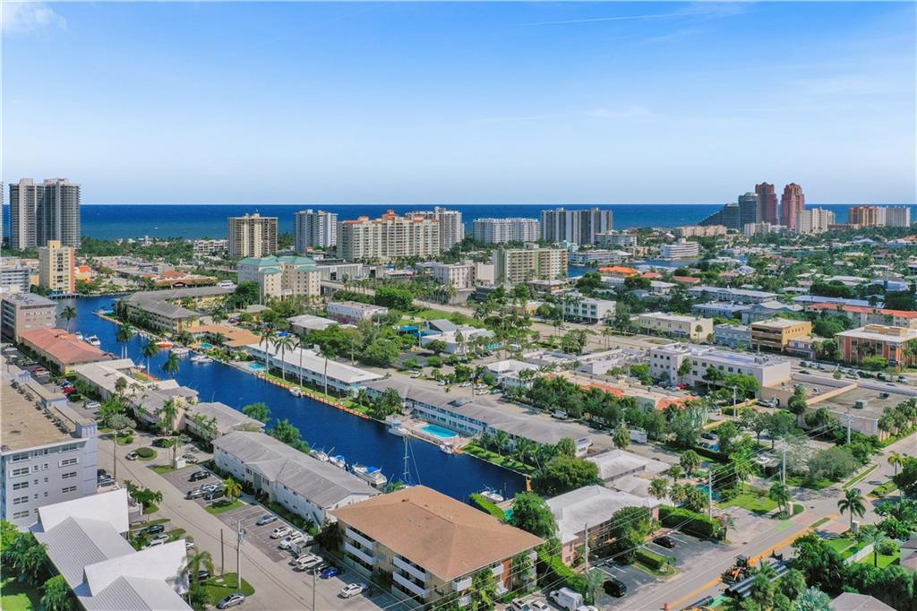 Coral Ridge Waterfront Life. Delivered...Experience this completely updated light bright 1 bedroom/1 bathroom beach getaway with gleaming woodlike porcelain tile floors on the 2nd floor of the Alexander Hamilton building just east of Bayview Dr. Live in the heart of Fort Lauderdale's East side walking distance to the beach, shopping, dining, and Coral Ridge CC. White kitchen & Granite countertops. Huge custom closet. Ocean breezes and south facing pool, this unique opportunity will not last long. Meticulously manicured and maintained, both the inside and outside of this property is truly astonishing. Only 19 units, only 5-7 full time residents. New Central A/C. Dockage waiting list available. No fixed bridges. Washer & Dryer on each floor. 2 tandem reserved spots. Furnishings Negotiable.