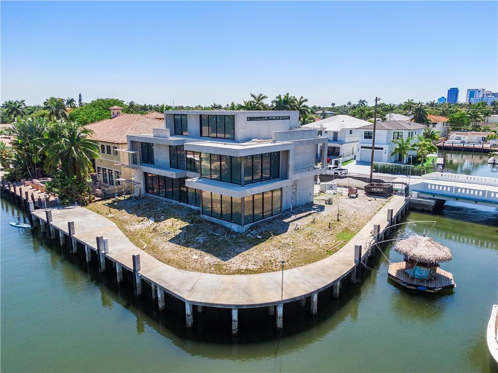 Introducing another superb waterfront property by Prince Bay Luxury Homes. This one-of-a kind luxury estate with a grandeur presence on Las Olas, offers the highest quality design + architecture. This home has 3 stories of ultra luxury living. Under air areas are 2722 on main floor, 2639 on second floor and 1195 on the sky high third floor. The home is built with 100% concrete including all roofs, the best system for floors which is poured in place 100% concrete. Visit the site now to appreciate the quality prior to drywall. True masterpiece by collaboration of Prince Bay Luxury Homes and Choeff Levy Fischman...equipped to meet the highest standards and lifestyles. Move into this house in 2021 or let's have another one designed and built by Mario Moeinifar, Prince Bay Luxury Homes. Introducing another superb waterfront property by Prince Bay Luxury Homes. This one-of-a kind luxury estate with a grandeur presence on Las Olas, offering the highest quality design + architecture. This home has 3 stories of ultra luxury living. Under air areas are 2722 on main floor, 2639 on second floor and 1195 on the sky high third floor. The home is built with 100% concrete including all roofs, the best system for floors which is poured in place 100% concrete. Speaks to the luxury lifestyle and is located on over 200' of waterfront. A limited supply of lots comparable to this one ever come to the market. Visit the site now to appreciate the quality prior to drywall. Estimated completion is Q3 2021. True masterpiece by collaboration of Prince Bay Luxury Homes and Choeff Levy Fischman...equipped to meet the highest standards and lifestyles. Walk to the beach or Las Olas restaurants in minutes. Move into this house in 2021 or let's have another one designed and built by Mario Moeinifar, Prince Bay Luxury Homes.