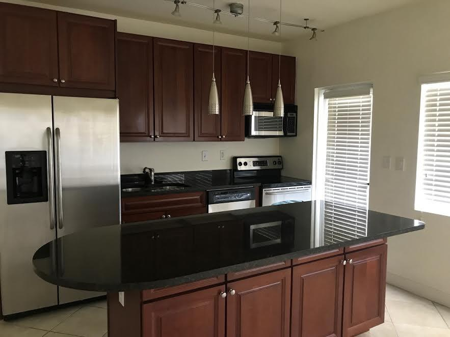 Beautiful high end corner unit on 3rd floor with well appointed floor plan! Higher ceilings on this floor! Great water views of the canal and Intracoastal, available boat dock w/no fixed bridges, huge open granite kitchen with stainless appliances, tons of rich wood cabinets & center island for cooking & more storage, spacious bedrooms and closets, granite vanities in baths, nice tile flooring in living areas w/carpet in bedrooms, neutral paint color, impact windows, secured building, prestigious Coral Ridge area, pool is directly on the Intracoastal and heated to use year round. BBQ grill area, bike rack. 2 parking spots, rare for area. No pets as per the association. Only a couple blocks to the beach, many great restaurants, dine in movie theater and much more! LOCATION !! LOCATION !!