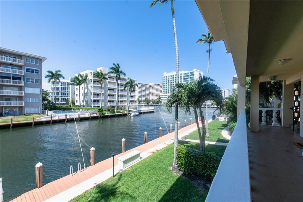Amazing Waterfront Condo in most Desirable Boutique Bldg, The WATERSIDE!! Great Water Views, Beautifully Updated, Hurricane Impact Windows and Doors, Tile floors thru out, Open Floor plan, Great Kitchen with Wood Cabinetry, Center Island w/Seating, Stainless Steel Appliances, Granite tops! Can Lease 1st year of Ownership, Pet friendly Building, Comes with an Extra Large Storage Unit. Waterside is located on a large ICW Point lot in Coral Ridge. Short Walk to the Beach Shops, Restaurants Complex offers a Heated Pool right on the Intracoastal and BBQ Area. Ideal for Year Round Living or to Lease!! Ready to move in and enjoy waterfront living at it's best!!!