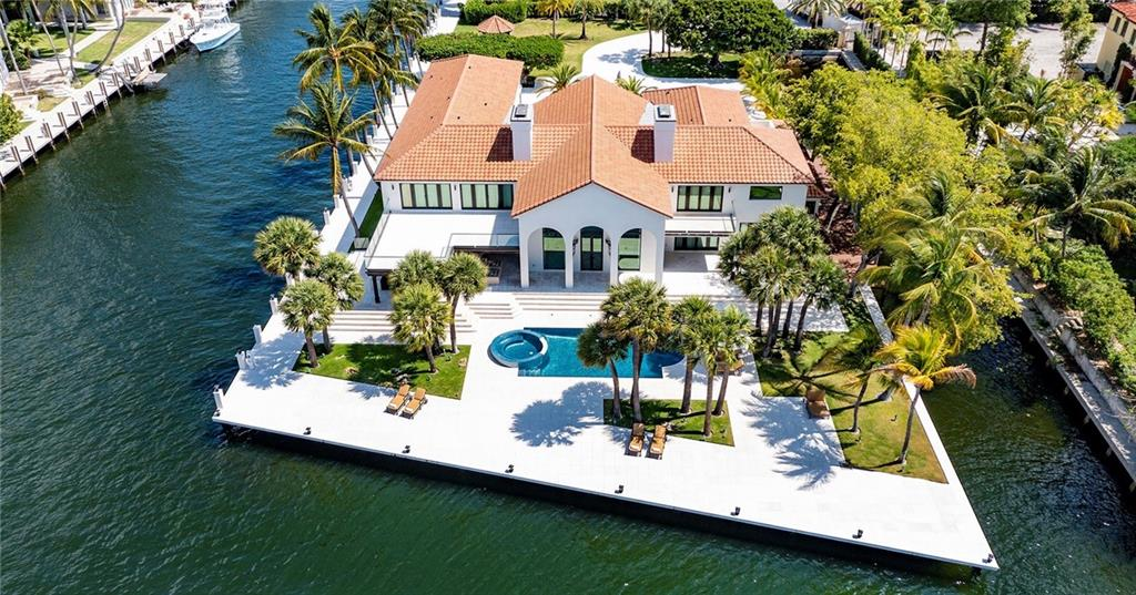 Villa Bontona Point Estate-A gated peninsula sited on 700+/- feet of New River waterfrontage in prestigious Las Olas Isles and developed by Innovative Creations Interior Design. An expansive motor court usher guests to this impressive waterfront mansion with wide limitless views from all major rooms. A Dual Chefs island kitchen features custom cabinetry and culinary appliances. Lavish Primary bedroom suite with spa-like bath & dual boutique-sized closets. Resort-like pool with spa, sprawling entertainment patio and loggia with summer kitchen. Amazing 265+/- of protected side dockage for a mega-yacht. Amenities include a 6-bay garage, two fireplaces, Crestron smart house, custom built-ins, European marble & move-in ready Designer furniture package. Shown by appt only to pre-qual buyers DISCLAIMER: Information published or otherwise provided by the listing company and its representatives including but not limited to prices, measurements, square footages, lot sizes, calculations, statistics, and videos are deemed reliable but are not guaranteed and are subject to errors, omissions or changes without notice. All such information should be independently verified by any prospective purchaser or seller. Parties should perform their own due diligence to verify such information prior to a sale or listing. Listing company expressly disclaims any warranty or representation regarding such information. Prices published are either list price, sold price, and/or last asking price. The listing company participates in the Multiple Listing Service and IDX. The properties published as listed and sold are not necessarily exclusive to listing company and may be listed or have sold with other members of the Multiple Listing Service. Transactions where listing company represented both buyers and sellers are calculated as two sales. The listing company's marketplace is all of the following: Vero Beach, Town of Orchid, Indian River Shores, Town of Palm Beach, West Palm Beach, Manalapan Beac