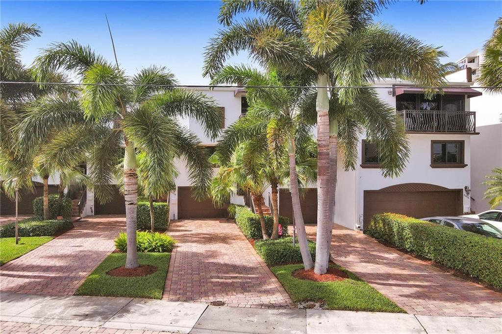 Spectacular waterfront townhome located in the exclusive neighborhood of Coral Ridge Country Club Estates and less than a mile away from shops and restaurants in Lauderdale by the Sea.This luxury townhome exemplifies the South Florida waterfront lifestyle, along with a wall of impact windows and doors overlooking your private deck with lush tropical landscape and 20' assigned dock.The interior features porcelain tile floors, updated kitchen and bathrooms, new appliances and volume ceilings offering the perfect combination for coastal-chill living. Primary bedroom features two walk in closets with built-ins. Loft area works perfect for an office or separate workout area.The association has just undergone a complete renovation to the exterior including new paint, dock lighting and landscape
