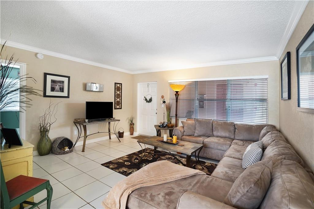 ADORABLE 1/1 CONDO IN THE HEART OF CORAL RIDGE. UPDATED AND READY TO MOVE IN BEING SOLD FURNISHED. EXCELLENT LOCATION 1 MILE TO THE BEACHES AND LAUDERDALE BY THE SEA. CAN BE RENTED RIGHT AWAY AND IS PET FRIENDLY WITH A COMMUNITY POOL. PERFECT FOR A SECOND HOME. EASY TO SHOW.