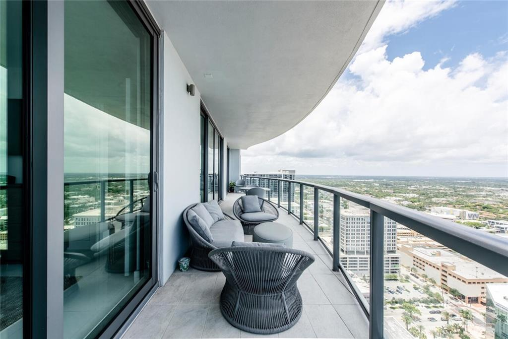 """HIGHEST """"B"""" FLOOR AVAILABLE! Imagine the impressive views from the 36th floor, soaring high above downtown Ft Lauderdale! 2BED+DEN/2.5BA luxury condo boasts a contemporary design with Custom Built-ins, California Closets, White porcelain tile throughout. Floor-to-ceiling windows with motorized black-out shades in bedrooms. Modern Kitchen w/ Nolte European cabinets, Quartz Counters & backsplash. Jenn-Air Euro Stainless appliances, Wine Cooler. Grohe & Koehler fixtures. Double panel sliding doors lead out to a 310 ft terrace with glass railings perfect for outdoor living & entertaining. Catch morning sunrises & evening sunsets and enjoy distant ocean views. Storage & 2 tandem-parking spaces. 4-Star amenities including a Hyatt Branded hotel on lower floors offers restaurant, bar & guest rooms"""