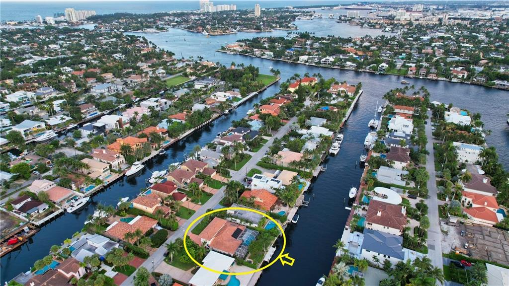 LAS OLAS ISLES, WHERE TROPHY PROPERTIES RESIDE. BEST-PRICED FOUR-BEDROOM HOME! NO FIXED BRIDGES AND SURROUNDED BY ITS OWN PRIVATE DOCKAGE, SOLAR HEATED POOL & MANICURED GROUNDS. THIS ELEGANT 3,400+ SQUARE FEET HOME FEATURES THREE OPEN LIVING SPACES FLOWING AROUND A CENTRAL OPEN KITCHEN, 4-WAY SPLIT BEDROOMS & A TWO-CAR GARAGE. THE PROPERTY IS LINED BY A 100-FOOT-WIDE CANAL AND IS LOCATED ON ONE OF THE CLOSEST RESIDENTIAL ISLES TO DOWNTOWN, THE OCEAN INLET, A MILE FROM OUR EXQUISITE WHITE SAND BEACHES AND JUST ABOUT 1000 FEET FROM GREAT RESTAURANTS, TERRACES, AND BOUTIQUES. THIS IMPECCABLY KEPT, ULTRA-CLEAN, LARGE HOME FEATURES A 75 FT. WATERFRONT, HIGH-SPEED FIBER OPTICS, 2-ZONES CENTRAL A/C, CENTRAL VAC. + GREAT FIND ON THE LAS OLAS WATERWAYS; NEXT PRICE ON THIS STREET: 7 AND 31 MILLION.