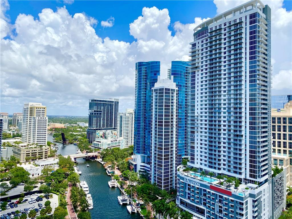 Highly upgraded sub penthouse level condo at NuRiver Landing. Located along New River & Riverwalk in Downtown Fort Lauderdale. Unobstructed west facing 24th floor view of the River, City, Spectacular Sunsets. 1 of only 3 floors with high 11 ft ceilings. Upgraded stainless steel appliances, Bosch AC, marble floors, crown molding, granite countertops, tankless water heater. Secure parking. Resort style amenities: 24 hour concierge, security, front desk, package room, rooftop pool w/ unrivaled panoramic city, river & ocean views, sky lounge, bbq grills, fitness center, basketball + racquetball courts, yoga studio, jacuzzi, steamrooms, saunas, business center, meditation garden. Walk minutes to Las Olas Blvd for restaurants, shops, nightlife, entertainment. HOA includes all + unlimited water! LOCATED DIRECTLY ON THE RIVERFRONT. DETAILS: NuRiver Landing is located directly along the New River which connects to the Intracoastal Waterway and Atlantic Ocean. NuRiver Landing is adjacent to the Riverwalk, a pedestrian-only walkway lined with boats and lush, tropical scenery. It winds along the north and south sides of the river and links together the neighborhood homes, restaurants, parks and shops. From the Riverwalk, enjoy watching luxury yachts, boats of all kinds, kayaks and more. WALKING DISTANCE TO LAS OLAS BLVD. DETAILS: Walk over the bridge within minutes to Las Olas Blvd which features countless restaurants, art galleries, fashion boutiques, cafes, bars, hair salons and more. Live entertainment is common and the diverse dining scene spans all tastes and budgets, and ranges from pet-friendly sidewalk cafes to craft pubs, breweries and luxurious five-star restaurants. Whether you're looking for a low-key breakfast, high energy brunch, casual dining venue or nightlife, there's something for everyone on Las Olas Blvd. PROXIMITY TO ADDITIONAL ATTRACTIONS. DETAILS: A quick drive to Fort Lauderdale Beach, Port Everglades cruise port, Fort Lauderdale Hollywood International 