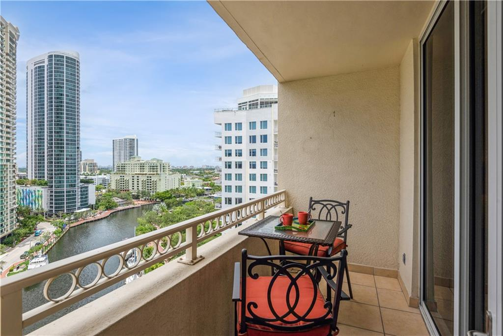 """DIRECT RIVER FRONT 2BED/2BATH residence! Relax on your private balcony and watch the yachts go by in the heart of downtown Fort Lauderdale. This unit boasts tile floors w/ wide 5"""" baseboards & crown molding throughout. Spacious open concept floorplan w/ split bedroom layout is perfect for your lifestyle. Kitchen features stone counter/backsplash, pendant lighting, Italian shaker style cabinetry and all new stainless steel appliances. Bathroom countertops match same kitchen counters and outfitted w/ round metal sinks/finishes. Secondary bedroom also faces north directly on the river which can serve as a welcome guestroom or a spacious home office or nursery depending on your needs. Custom Closets. Tankless Water Heater. New A/C. Full Size Washer/Dryer Negotiable. Furniture Negotiable."""