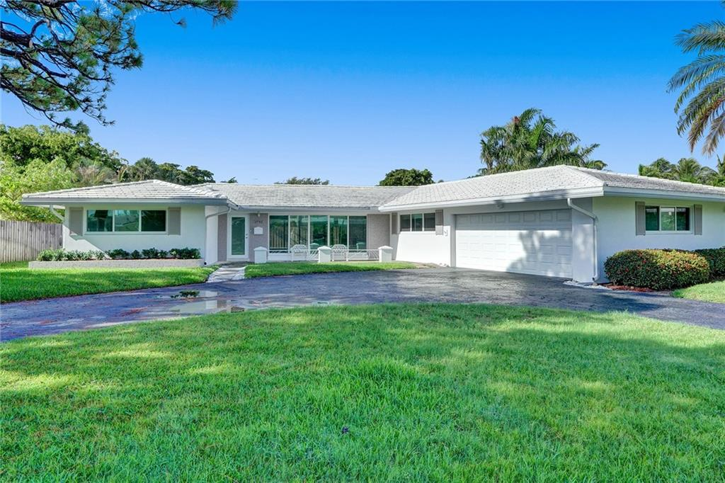3 bedroom 2 bath home located in the heart of Coral Ridge Country Club. Roof 2019! Impact windows and doors! Terrazzo flooring throughout, reconditioned in 2019. Updated kitchen and baths! Split bedroom floorplan. Large 2 car garage with storage. Backyard features grass area and screen-in patio.