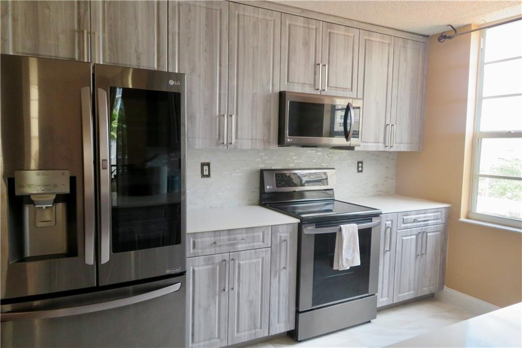 This 3 bedroom, 2 bathroom corner condo has an office or den that can be used as a 4th bedroom. Remodeled open kitchen with new appliances this year 2021 with 10 year warranty, convection oven 5 burners, smart fridge with wifi and quartz countertops. Open balcony off the living room. Washer & dryer 2 years old with 5 year warranty. Lots of closet space. There are 2 garage spaces under cover 26 and 29. Amenities are amazing with heated pool, spa/hot tub, cabanas, exercise room, kitchen & BBQ areas, internet cafe, meeting room and 24 hour concierge. pet welcome under 20 lbs Fabulous building