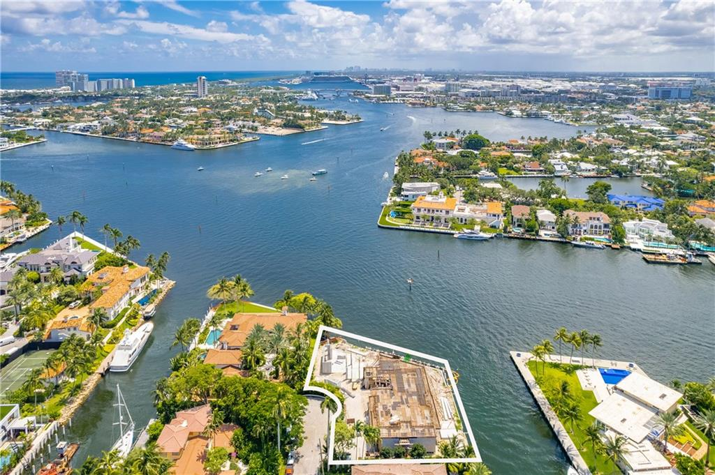 The ultimate yachting lifestyle estate! Impeccably designed point lot home located at the convergence of the New River & Intracoastal Waterway. This unparalleled property boasts 277' of water frontage w/mega yacht dockage, quick & easy ocean access, & breathtaking wide water views. Three-stories w/all of the amenities one could ever want; eat-in gourmet kitchen, family room, club room, elevator, 3rd floor sky lounge & more! Generous master suite & master bath w/amazing Intracoastal views, dual water closets & sinks. Oversized outdoor entertaining area w/lap pool, spa, outdoor kitchen and vast covered spaces to soak in the sun and views. Outstanding South Las Olas Isles location; walking distance to shopping, fine dining & the beach. Available for purchase during any phase of construction.