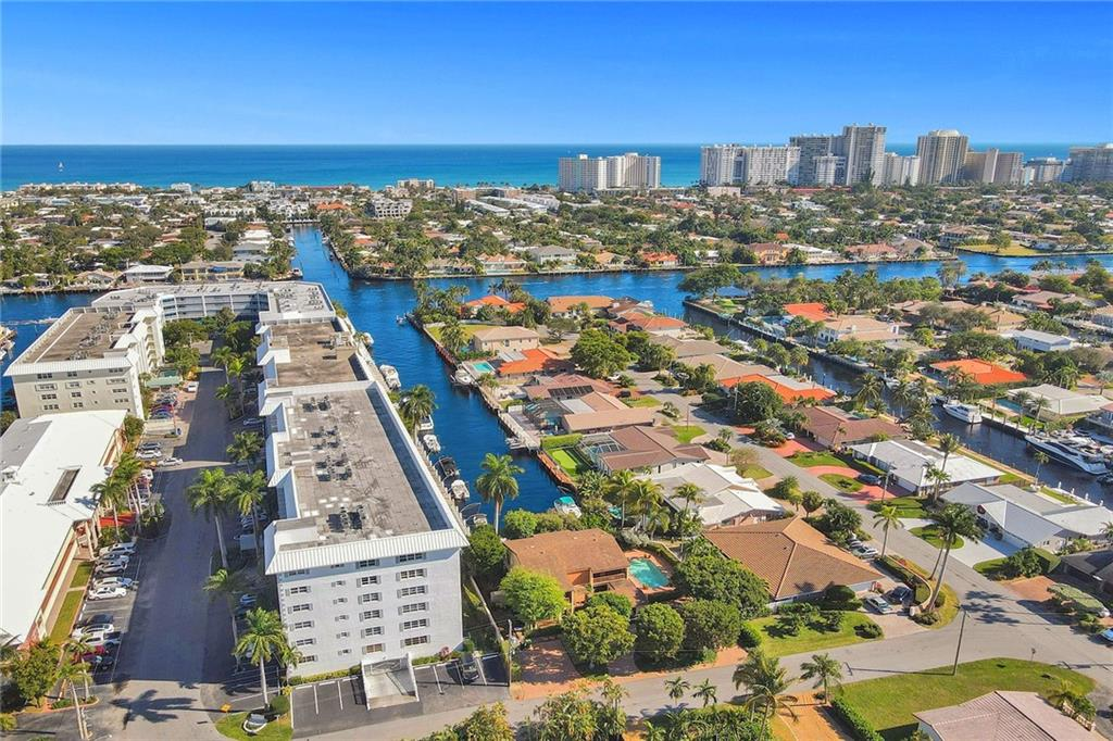 Must see this renovated 2BR/2BA waterfront condo in the beautiful Coral Ridge Country Club neighborhood. Light and bright, this rarely available corner unit features wood flooring, impact windows, ss appliances, granite countertops, laundry room, custom closets, built in home office, built in display shelving in living areas, formal living and dining areas, extra spacious rooms. The Winston House is a well maintained 6 story boutique building with just 46 units, waterfront heated pool overlooking single family homes, renovated community room and common areas, reserved secure underground parking, plenty of guest parking, storage locker, bike storage and more. Dockage $4 per foot plus electric, when available. One mile to beach, shopping, restaurants & entertainment.