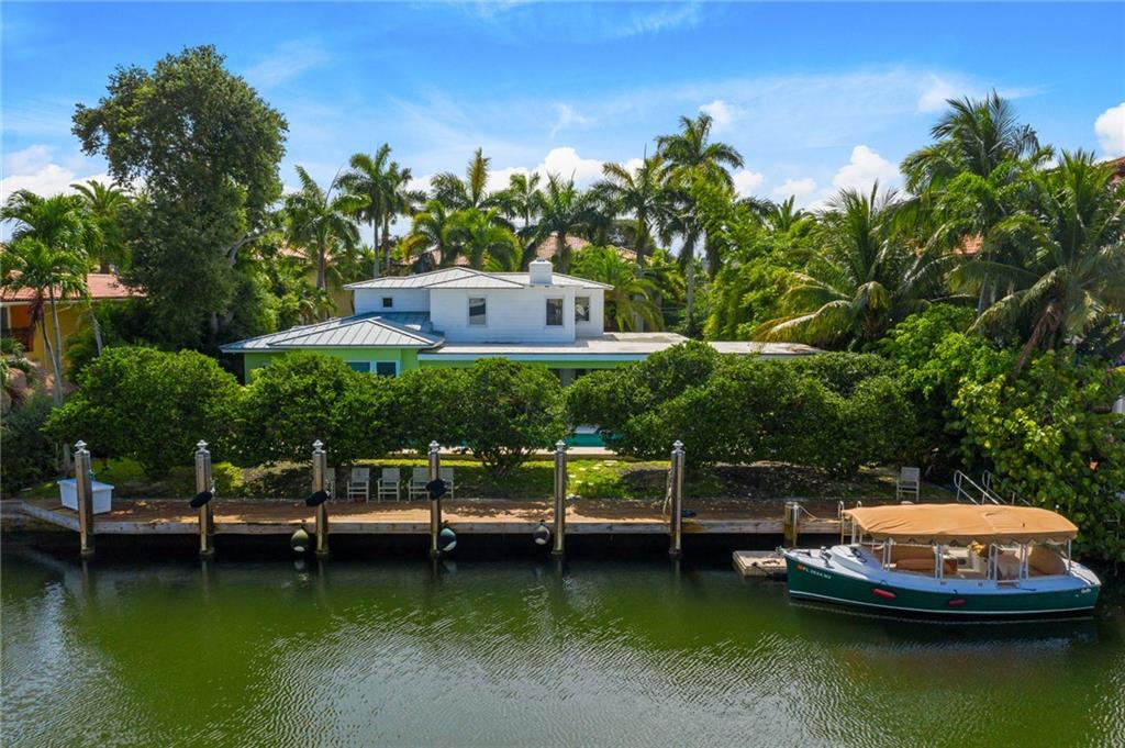 Key West and Caribbean charmer on beautiful Isle of Palms. Includes 100 ft. deepwater and accommodates an 80 ft. yacht with the set-backs. Major retrofit approx. 15 years ago and includes a Metal Roof, Newer kitchen, New 1st level Master Suite, Added Large Loggia prepped for Summer Kitchen with Gas and Water, Generac Natural Gas Generator, Impact Glass. Floors are hardwood and Saturnia marble. Added ground level Master Suite has high ceilings and a generous sized bath. 1st level includes two bedrooms, 2 baths, & outdoor powder room. 2nd level offers 3 bedrooms and 2 baths. One of the very picturesque streets in South Las Olas with quick ocean access for the boaters. Lot size is 100x 130.