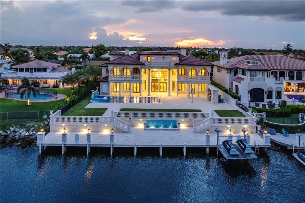 Waterfront Palace in Lighthouse Point! This 7 bed, 9 bath mansion with a 100ft deck will take your breath away. A modern interpretation of the classic European style, inspired by the Hermitage Museum of St. Petersburg. Hand-cut Jerusalem marble covers the entire outside, hand-carved marble pillars, & stunning views. Inside walls & ceilings made with Venetian plaster, applied by hand by the late Gregory Slyuta. Stunning hand-assembled stained glass & imported marble floors. Chandeliers & sconces with embedded Swarovski Crystals & 24-carat gold leaf in every room. Control4 audio-visual system & Light system, Lochinvar water heater, NuTone central vacuum, A wine room, multiple wet bars, top-of-the-line appliances & equipment, and Phylrich fixtures. Excellent location, this home is a must-see!