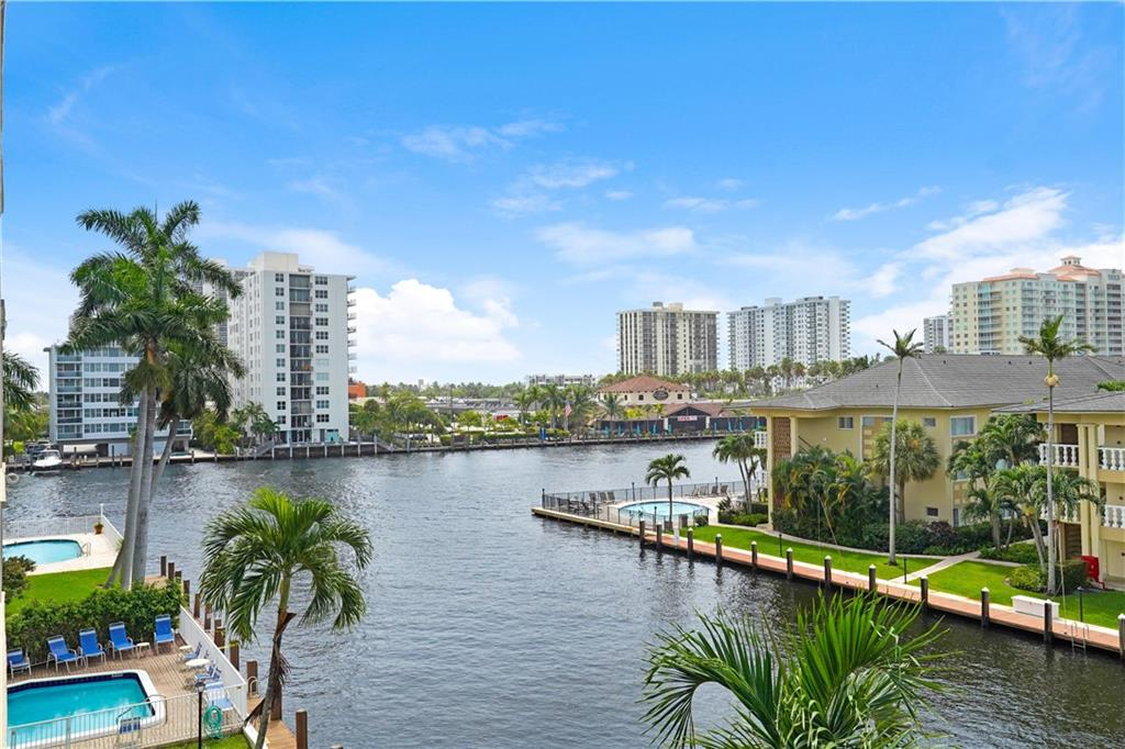 Just kick back, relax on your private 3rd floor balcony with this fantastic opportunity to live right off the Intracoastal in Coral Ridge County Club in this 2 bedroom | 2 bath condominium. Bring your boat! Boat dockage available for Hawthorne Manor residents at $3.50 per linear foot per month. This property comes with 1 1/2 parking spaces adjacent to park an oversized vehicle. Beautiful wood laminate flooring throughout the living room and dining area. Master bathroom has been updated recently & all hurricane impact windows, sliders to the balcony, and doors. Common laundry included in HOA fees. Beautiful plantation shutters in the master bedroom w/ phenomenal views of the intersecting canal and Intracoastal. Close to Bokampers, Shooters, and less than a 1/4 mile to the Atlantic Ocean! C