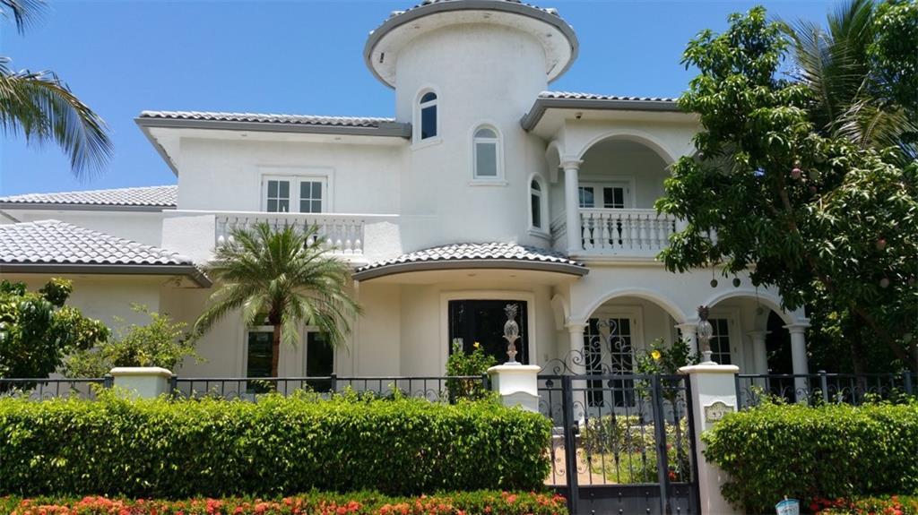 Magnificent oasis on the water. 7 huge en-suite bedrooms each with a large private patio or balcony. 2 bedrooms can be used as a spacious office and exercise room. Marble and Brazilian cherry wood floors throughout. 100' of deep waterfront with concrete seawall, dock and enormous 40k lb boat lift. Live the resort life in your huge backyard with a large lanai, huge wet bar, large pool w/side spa, plus free standing hot tub. New impact window and doors throughout. Easy walk to restaurants and beach.