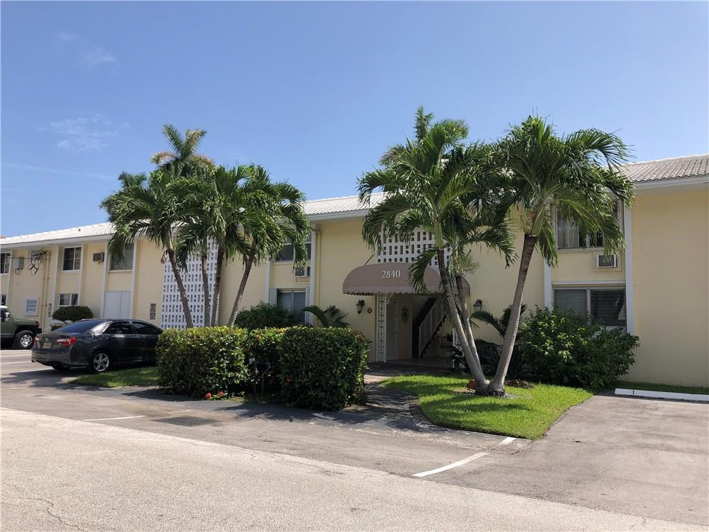 Looking for old Florida style living with modern flair? Look no further....this ground floor two bedroom corner unit is here for you! Currently in the process of getting new open concept kitchen with quartz countertops, wooden cabinetry and all new appliances. The full bath bas been remodeled, and there are tile floors throughout. There are impact windows on street side and accordion shutters for the others. Dockage is available to rent up to 30' when the new dock and seawalls are completed...in process of being replaced right now! Quiet complex of only 16 units, located 1/2 mile to beach, and just blocks to great restaurants, drug store, Coral Ridge shopping mall, post office and movie theater. Please inquire for private showing today!