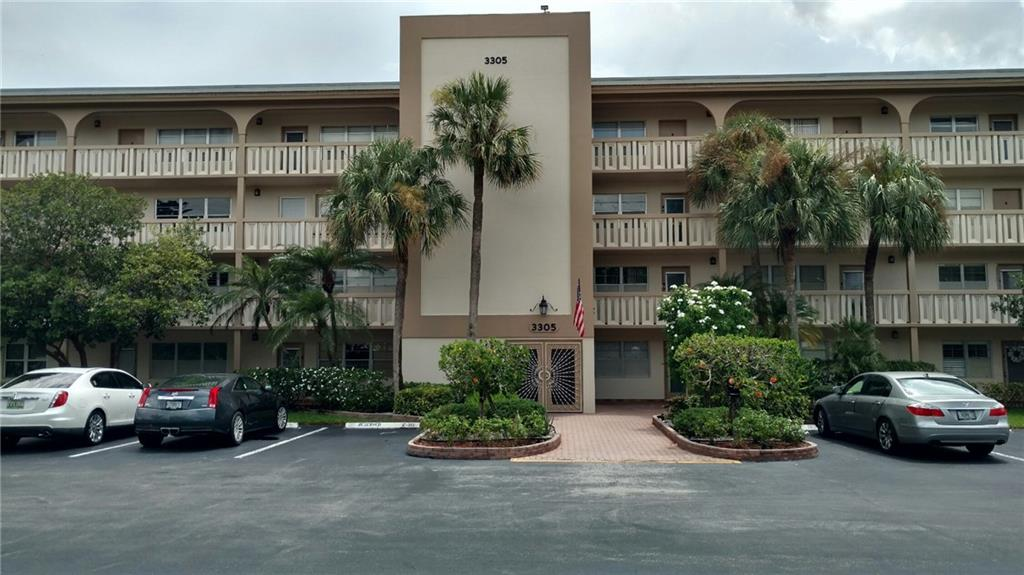Wynmoor 3rd floor unit in Aruba Village and next to elevator.  Beautiful pool view from patio. Washer and dryer in unit. New Storm rated door and storm accordion shutters on front windows and back porch, $5,000 invested. Extra storage area. Wynmoor offers many amenities such as: clubhouse, pools, cafe, theater, tennis, golf, gym, shuttle bus, etc. HOA fee includes: water, cable, trash/bulk pickup.  Association requires 20% down. 1 Owner occupy to be 55+. Min 650 credit score.  2 year wait to lease. Vacant.  Agent is related to the seller.